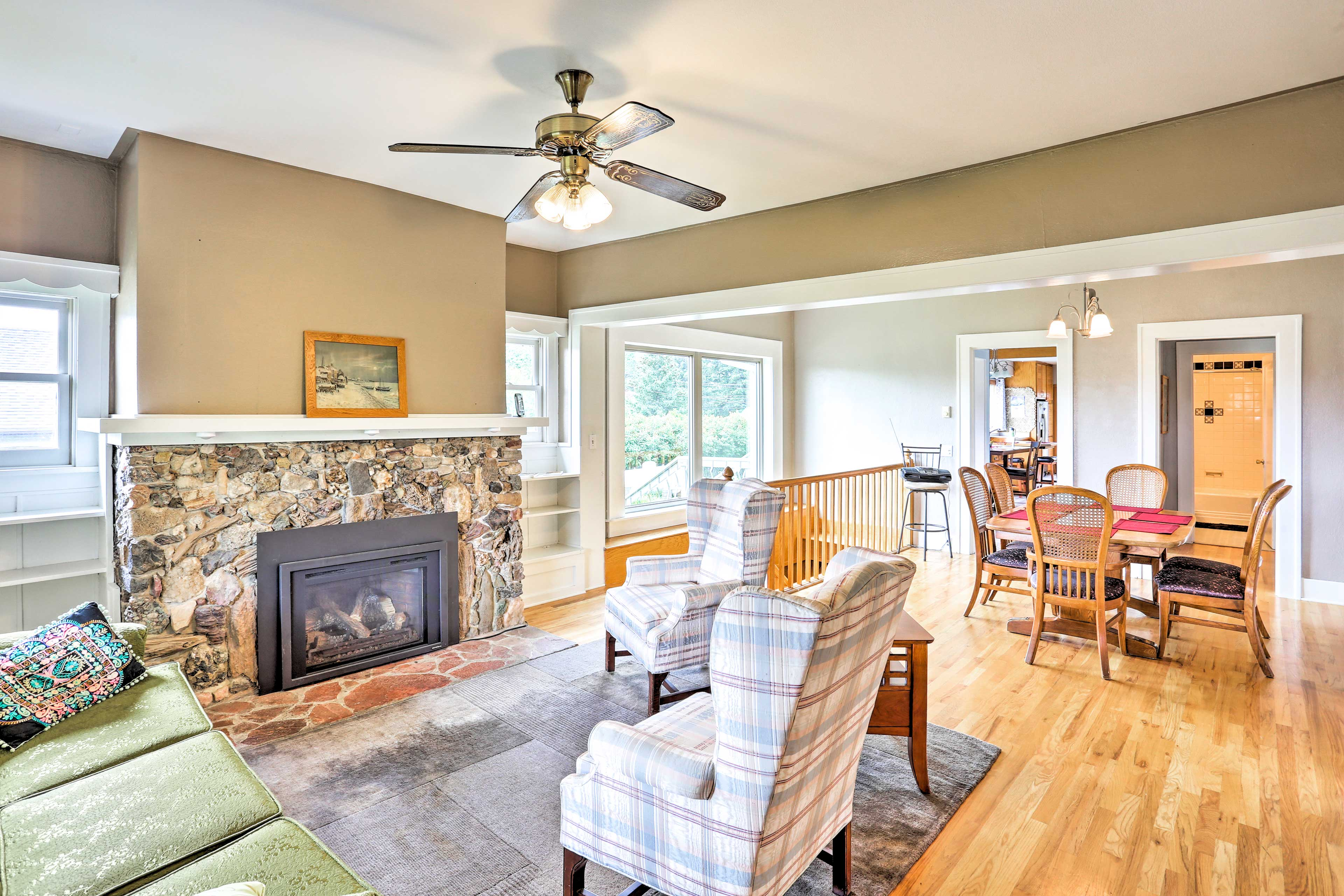 This 4-bedroom, 3-bath house includes multiple living spaces.
