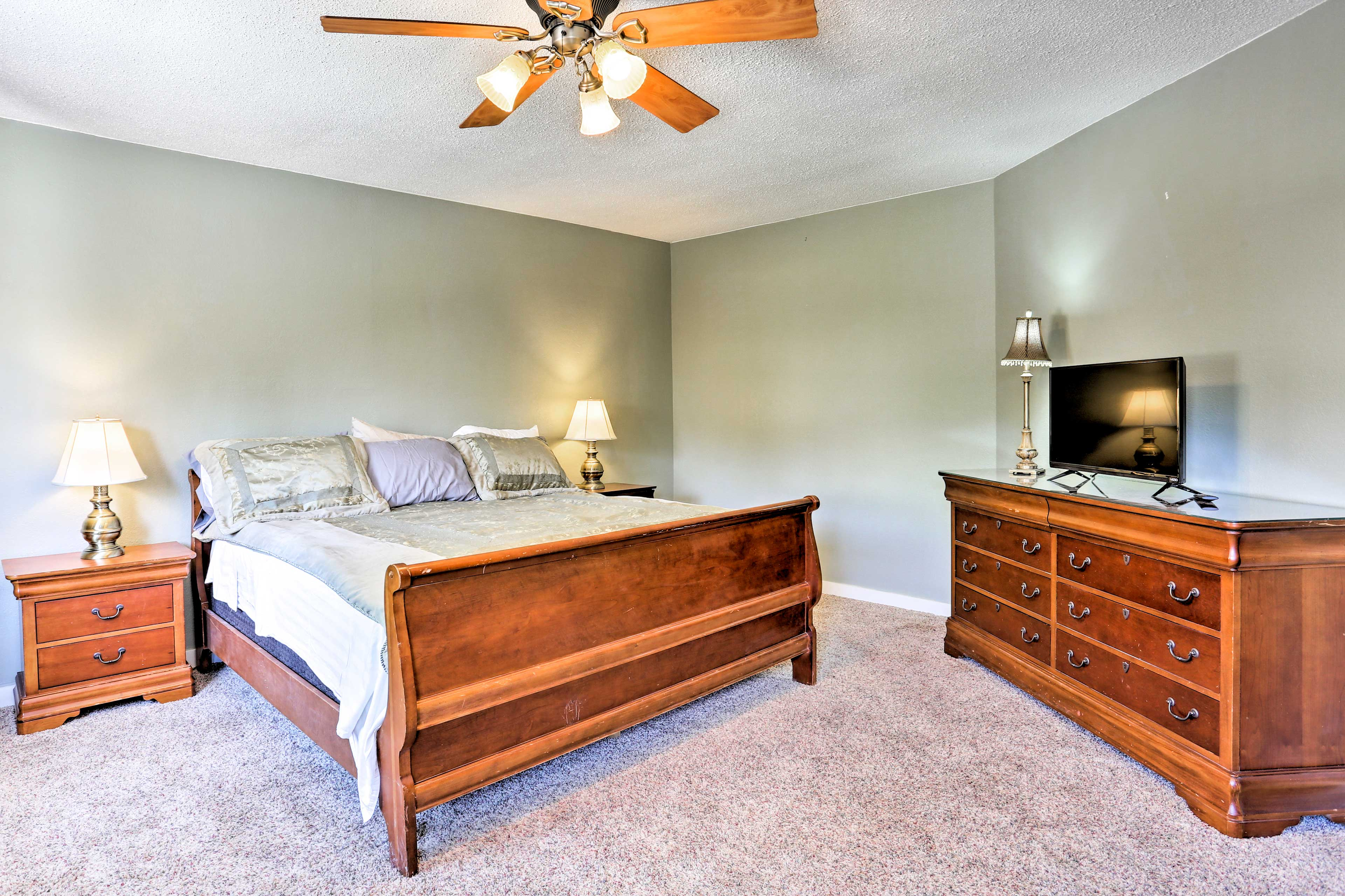 The master bedroom boasts a king bed and flat-screen Smart TV.