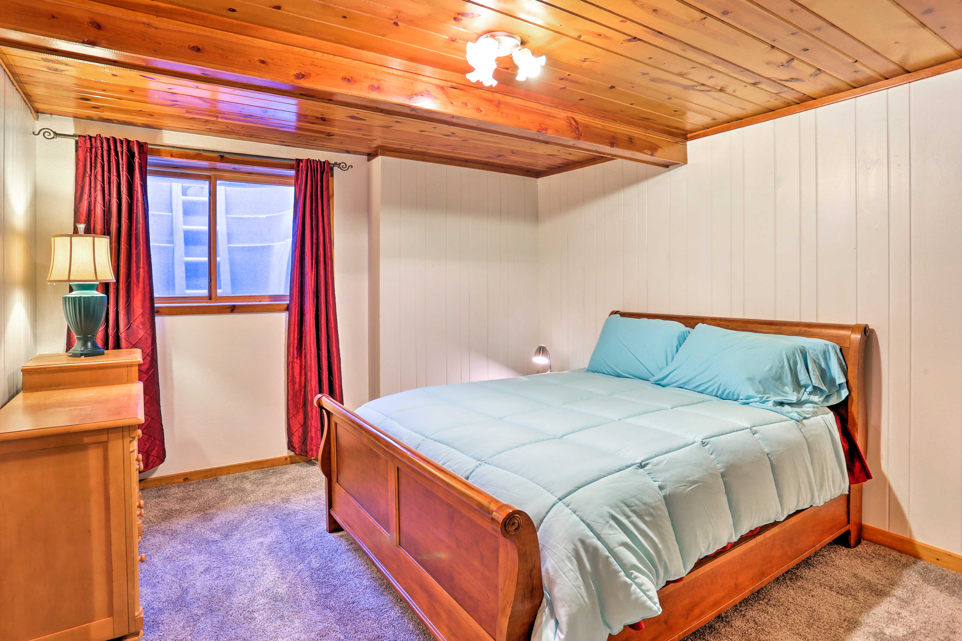 This lower level bedroom offers a queen bed.
