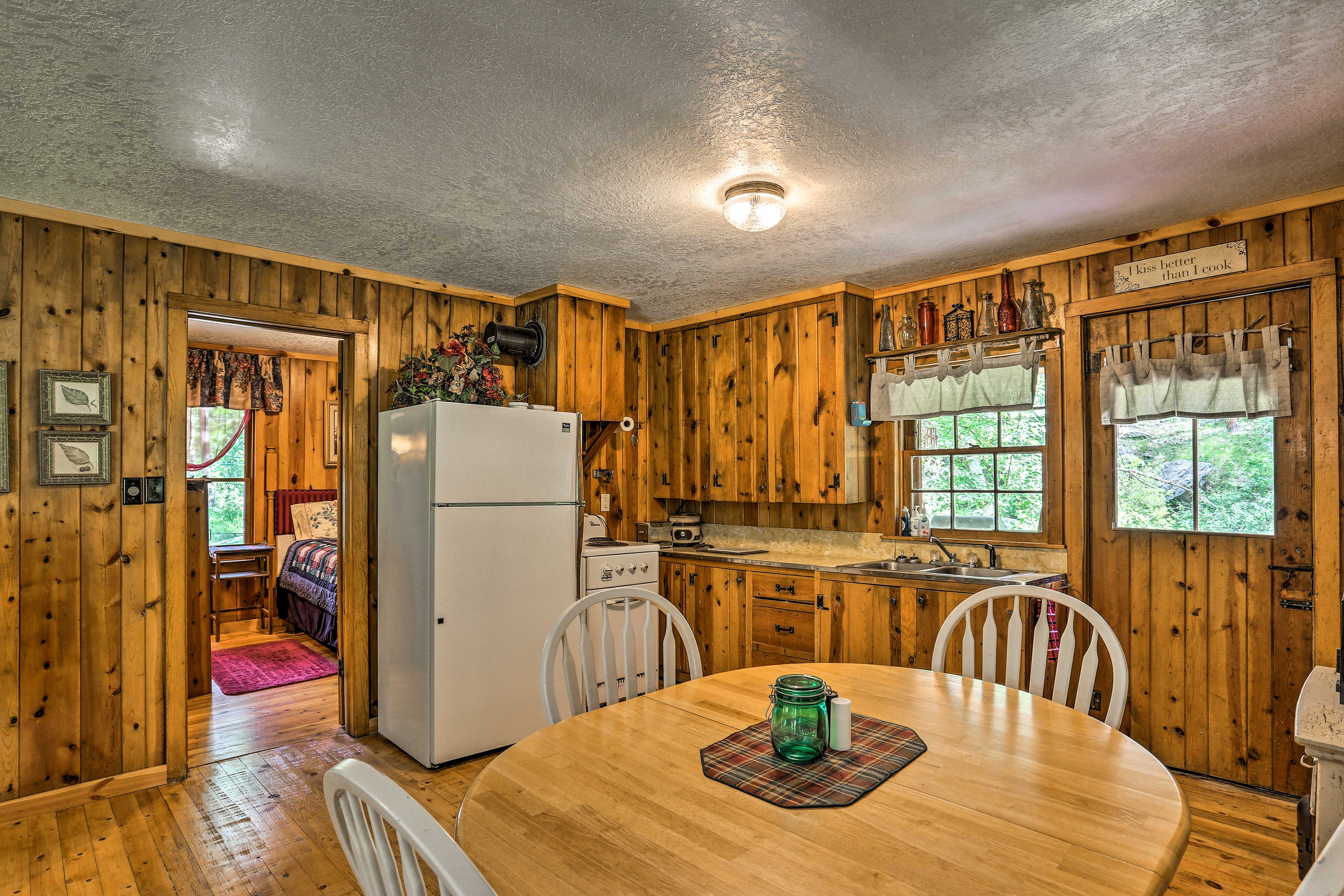 The kitchen is fully equipped with updated appliances.