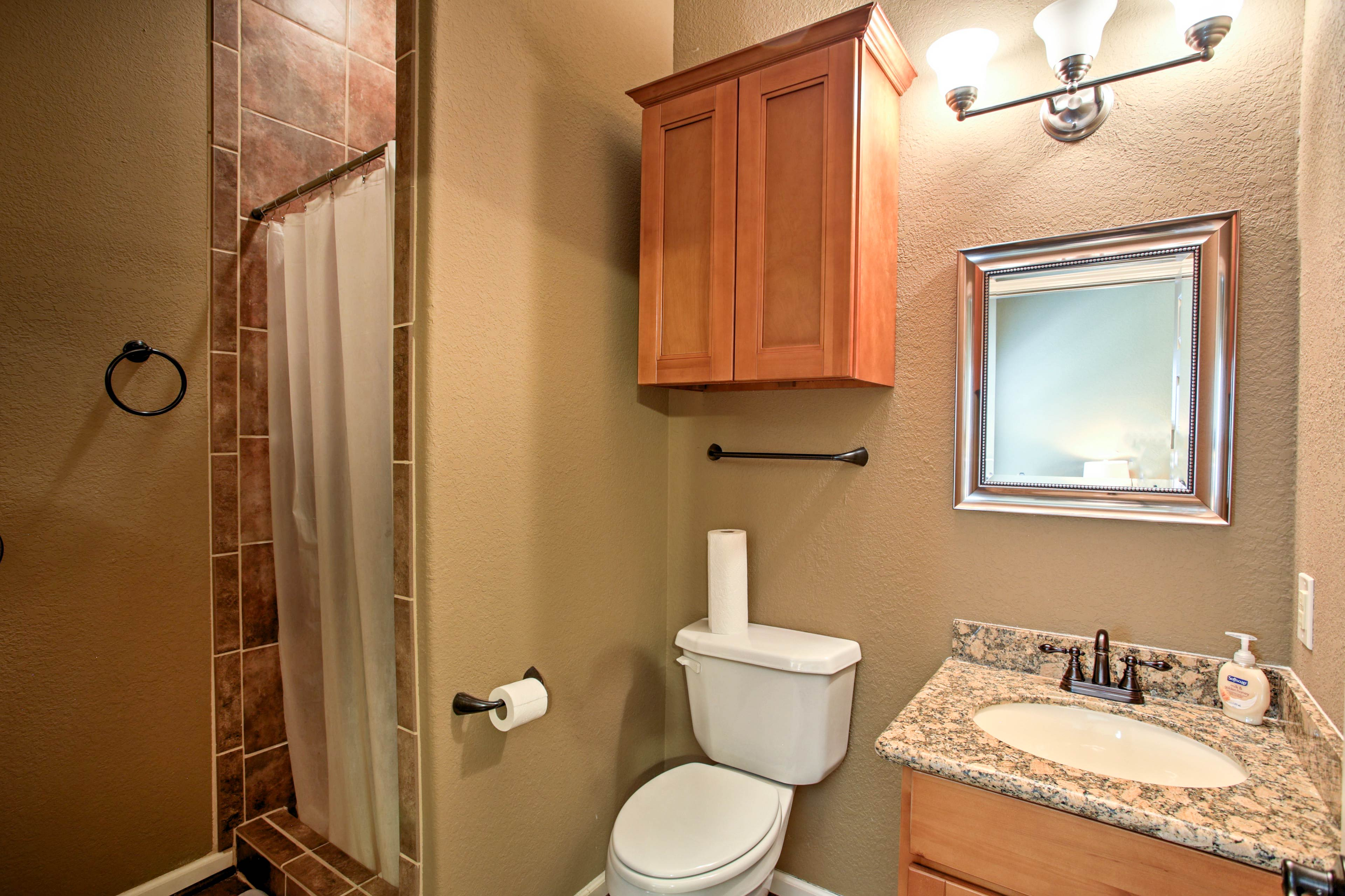 After a day at the lake, shower off in this full bathroom.