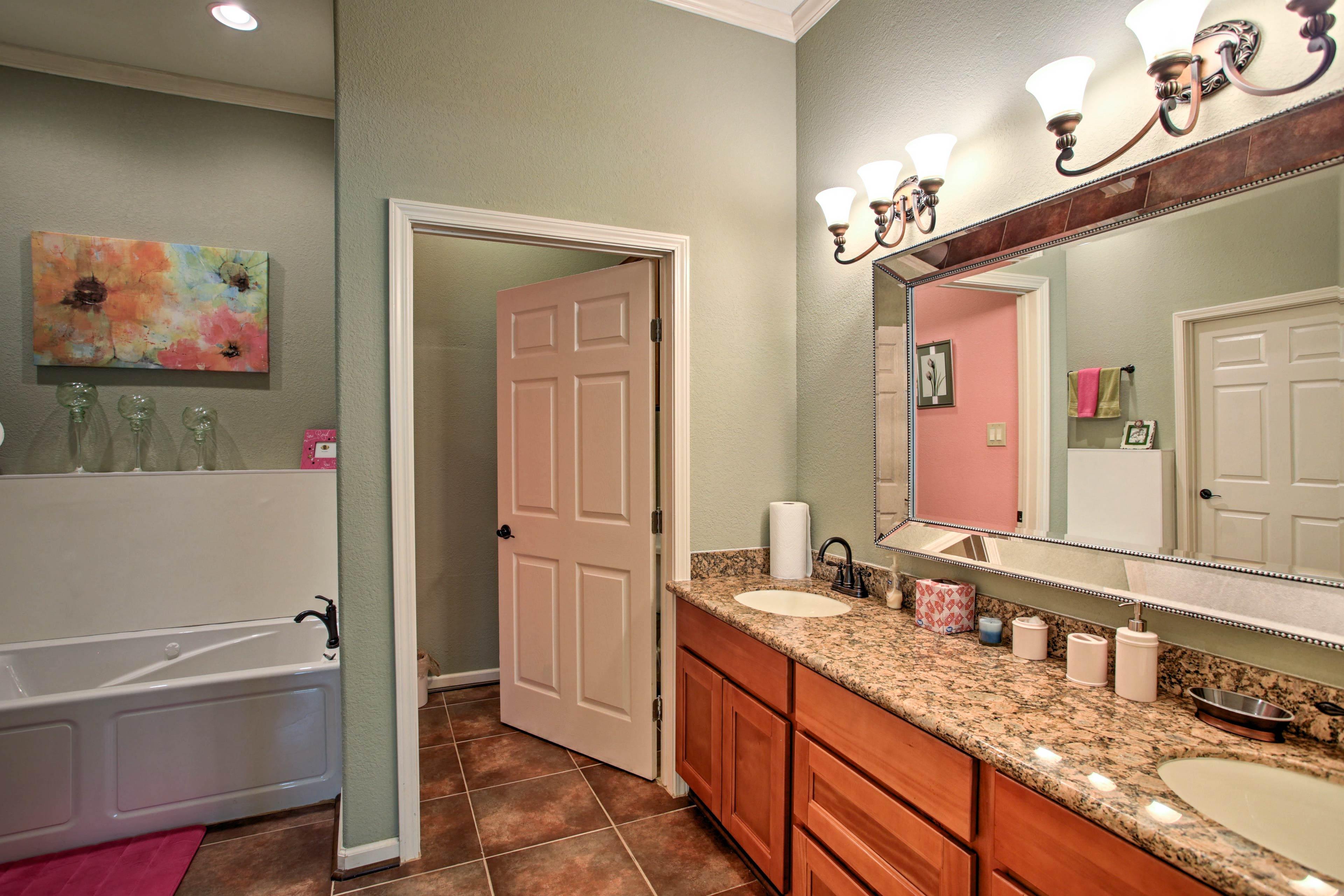 It features an en-suite bathroom, with a Jacuzzi tub.