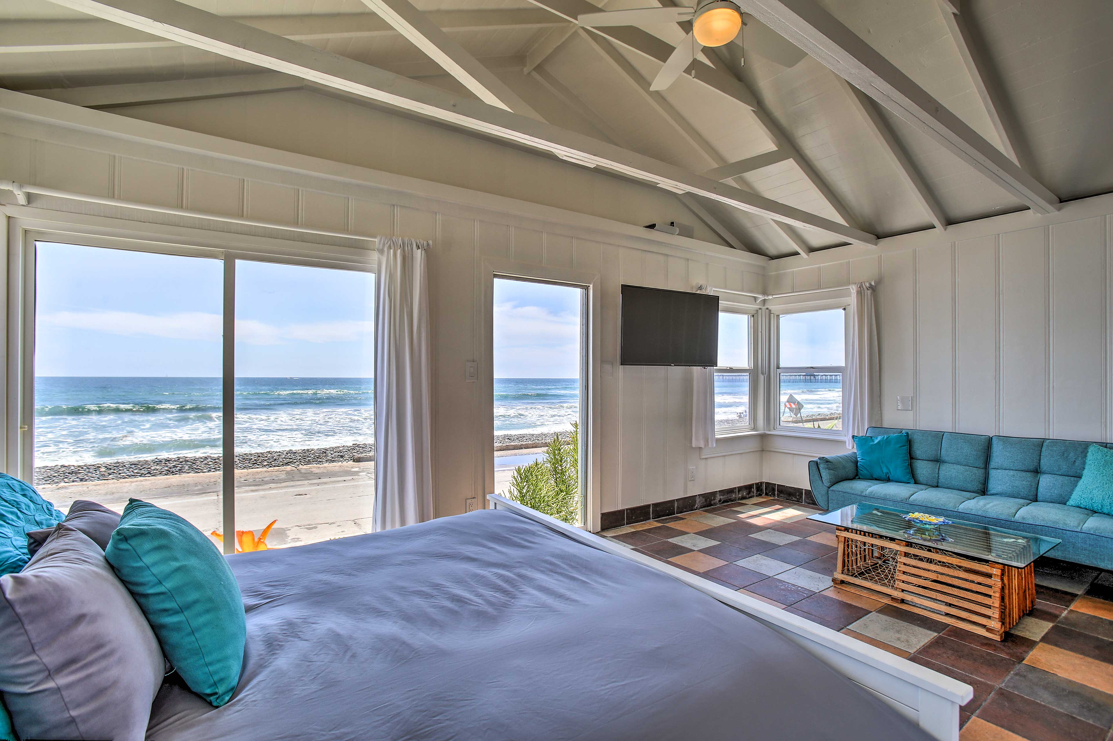 The cozy queen bed has spectacular views as well.