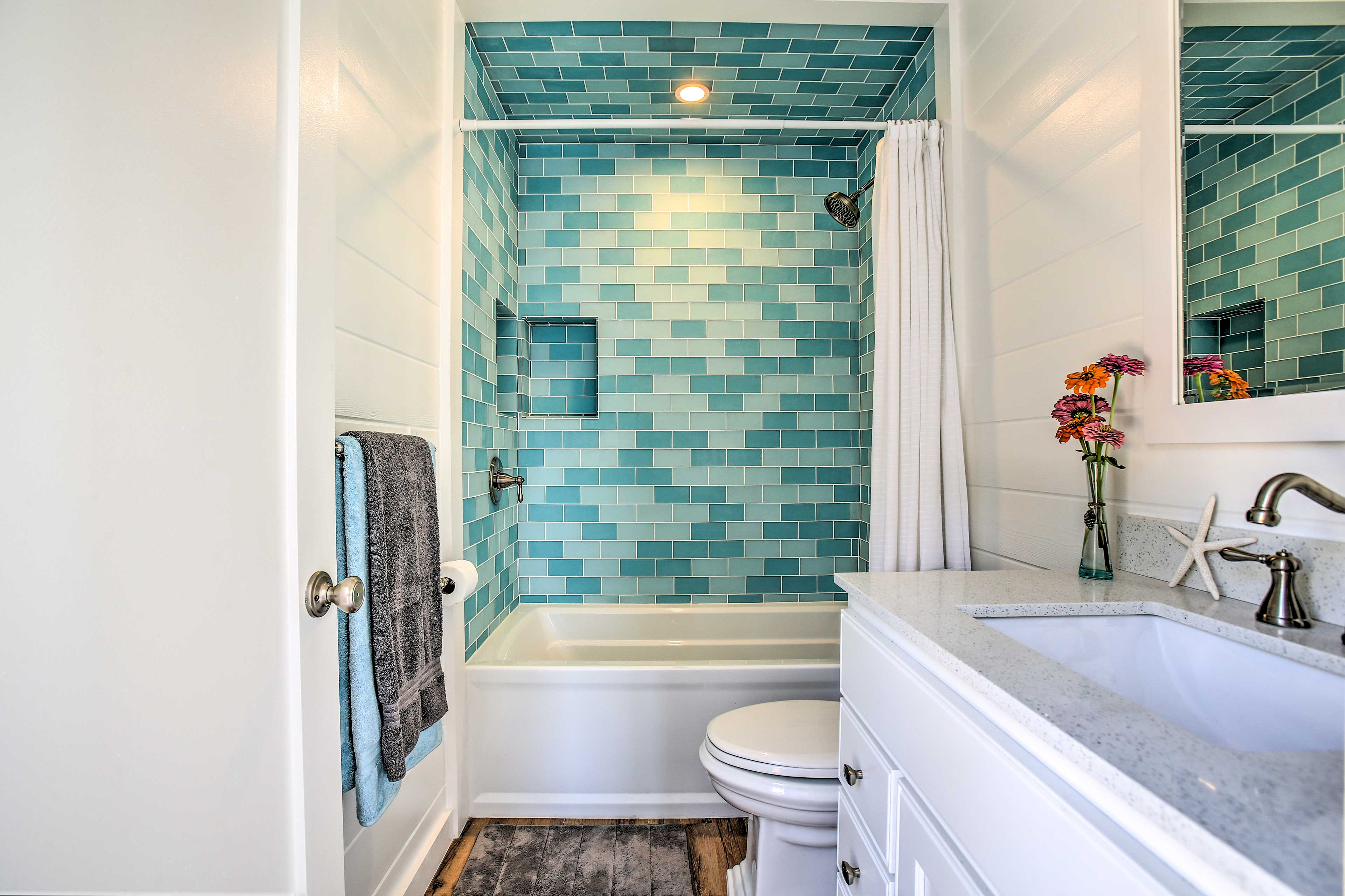 Get ready for you fun day in the blue-tile bathroom!