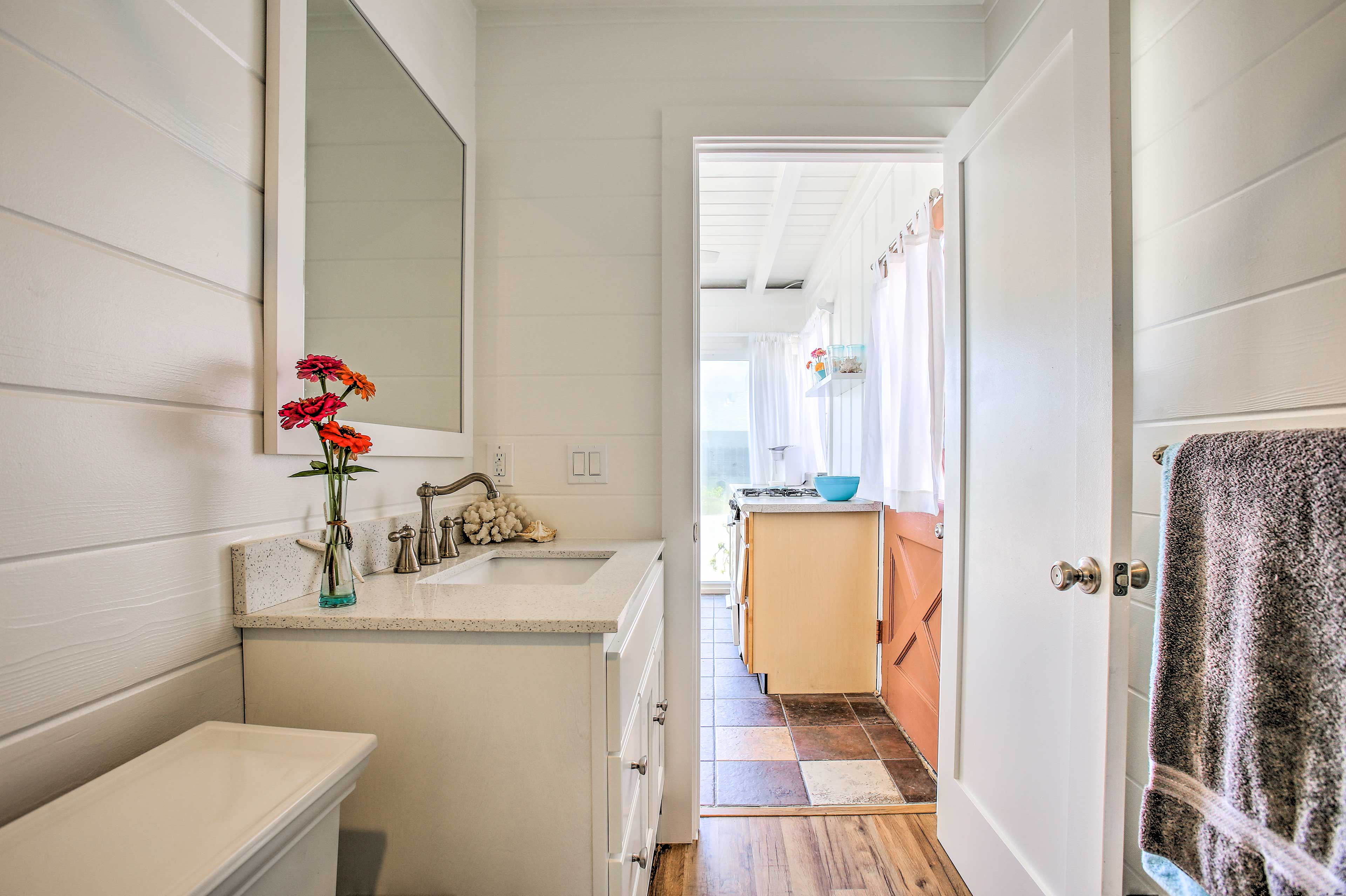 The coastal decor and white walls continue in this space.