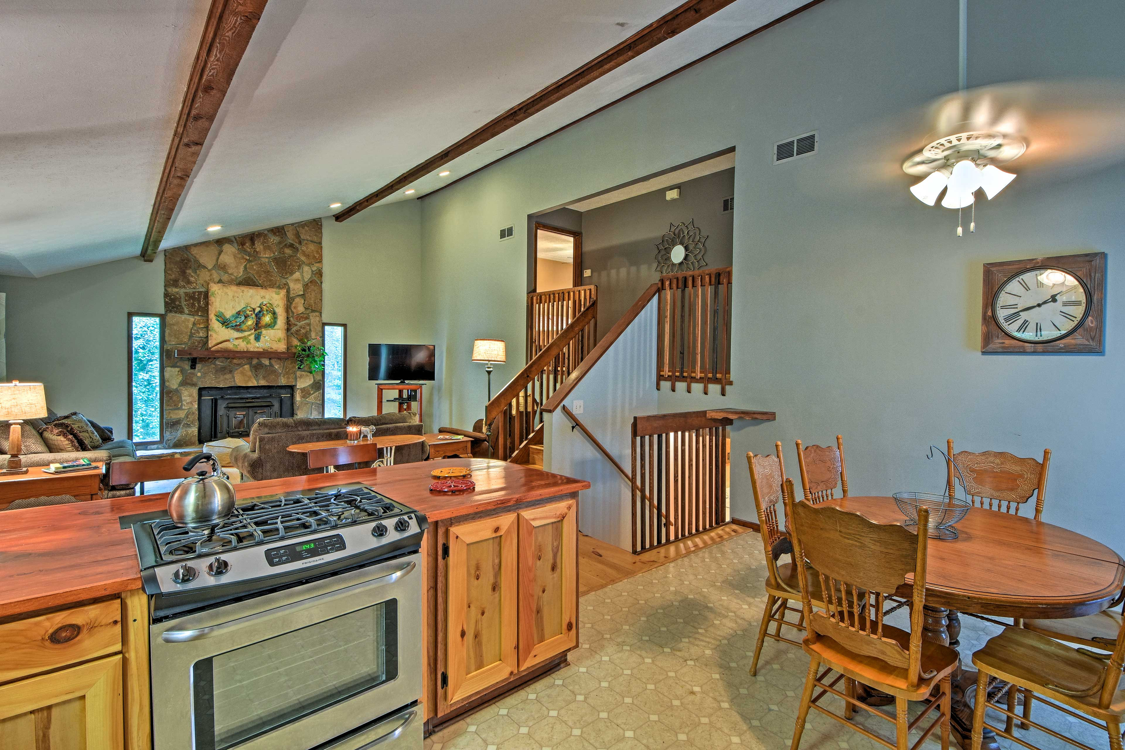 The wooden kitchen peninsula lets you chat with your group even while you cook!