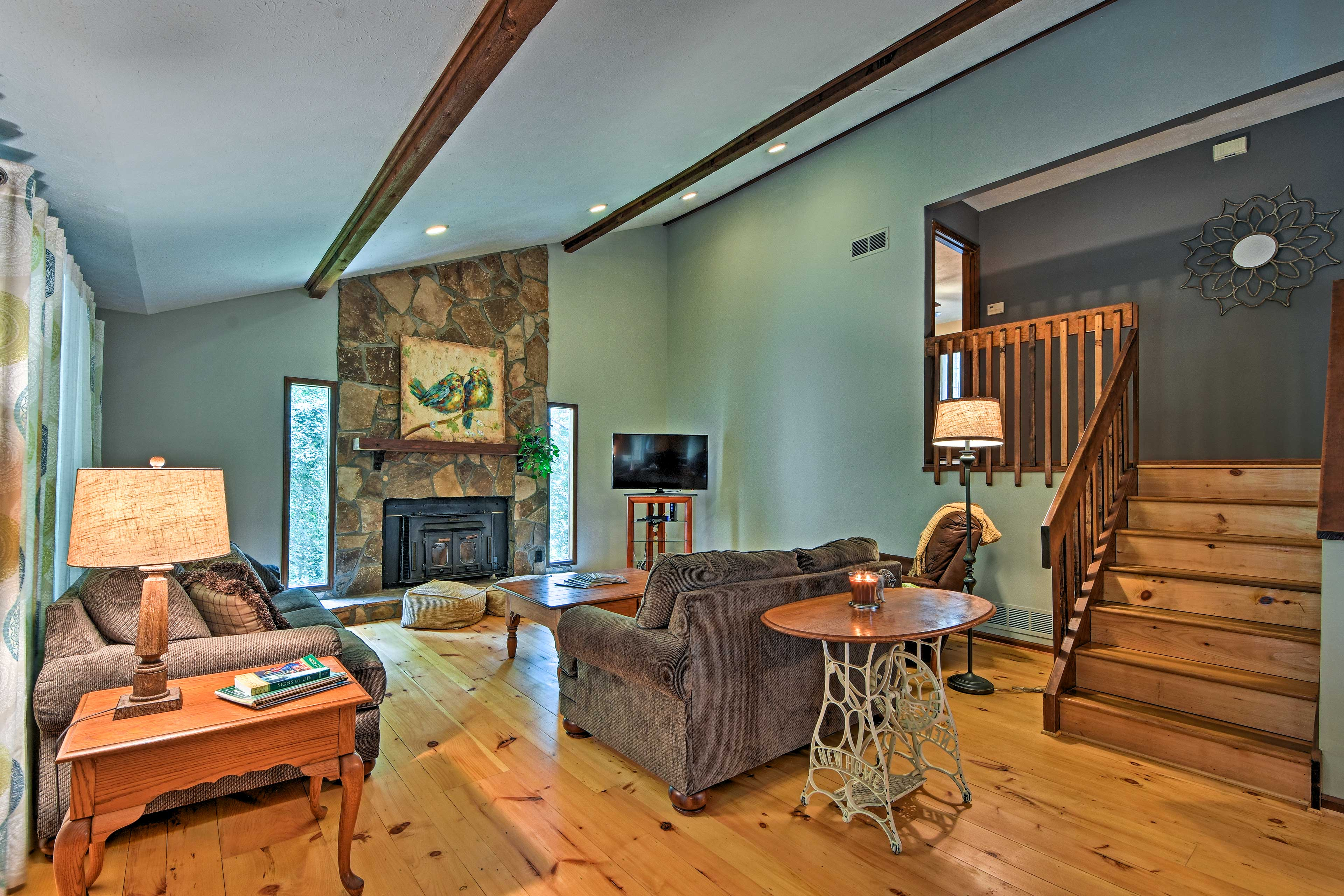 The split-level home boasts 4 bedrooms and 2 bathrooms to sleep 8 travelers.