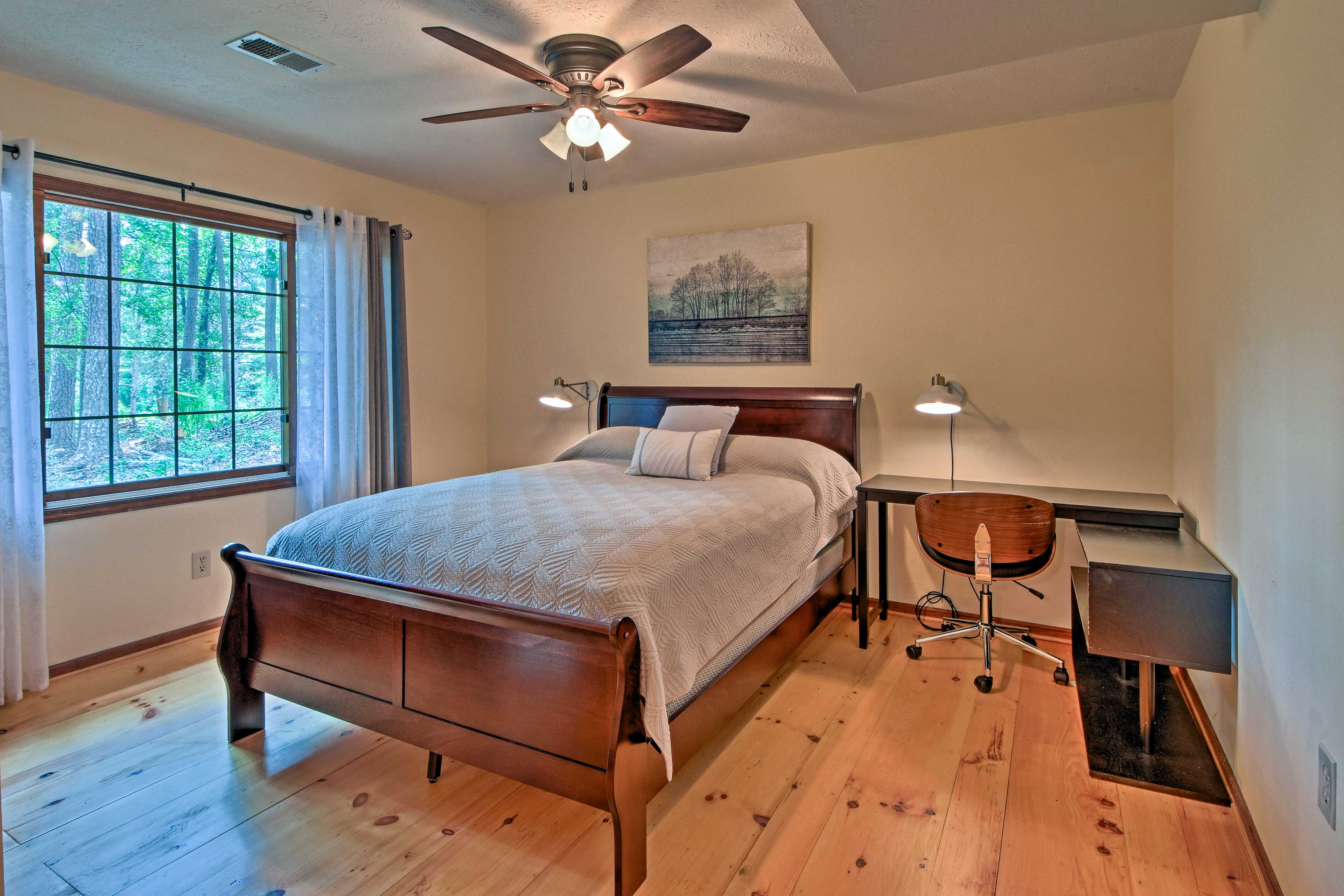 A plush queen bed furnishes the second bedroom on the lower level.