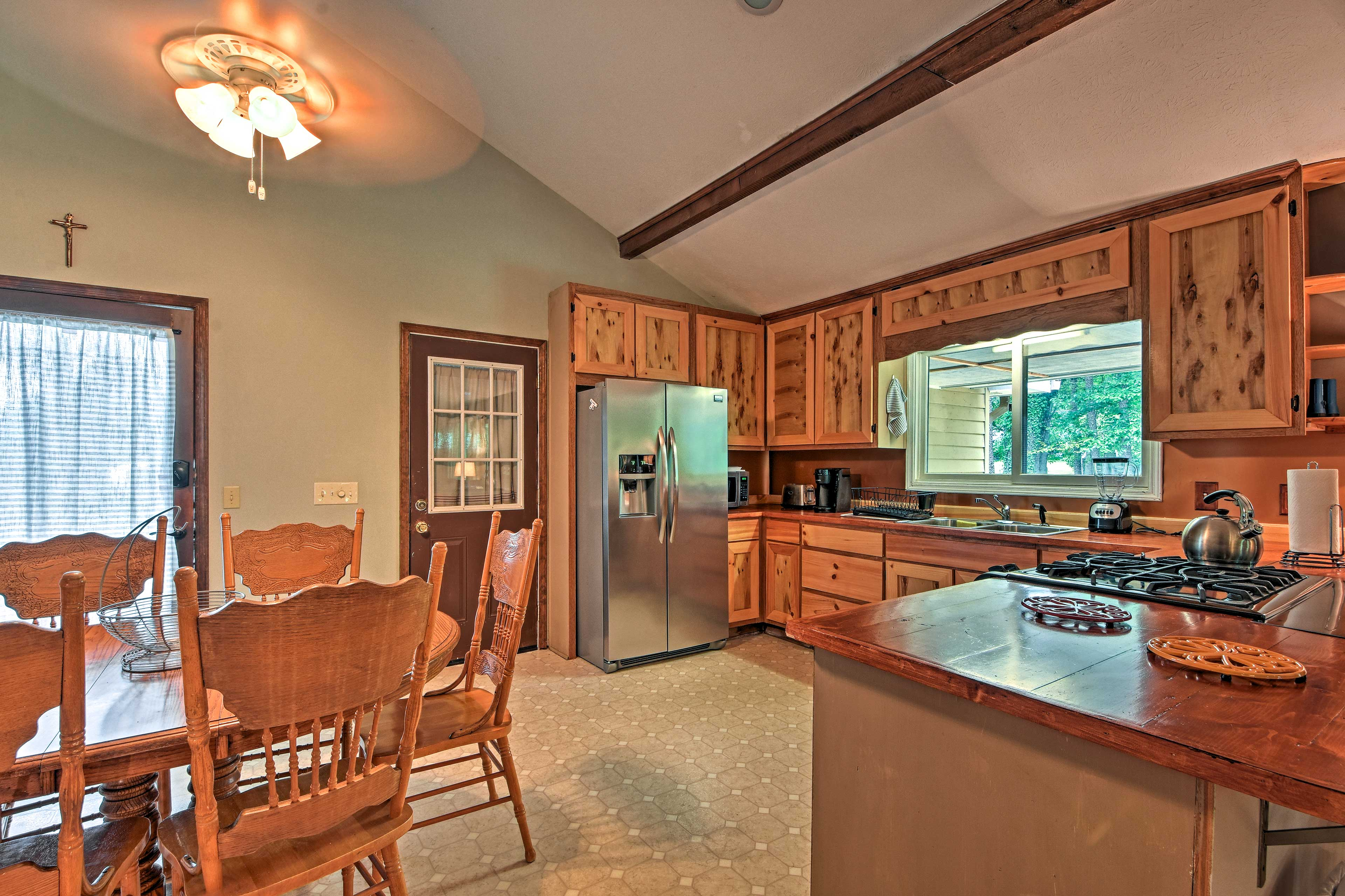 The open floor plan living area flows into the fully equipped kitchen.