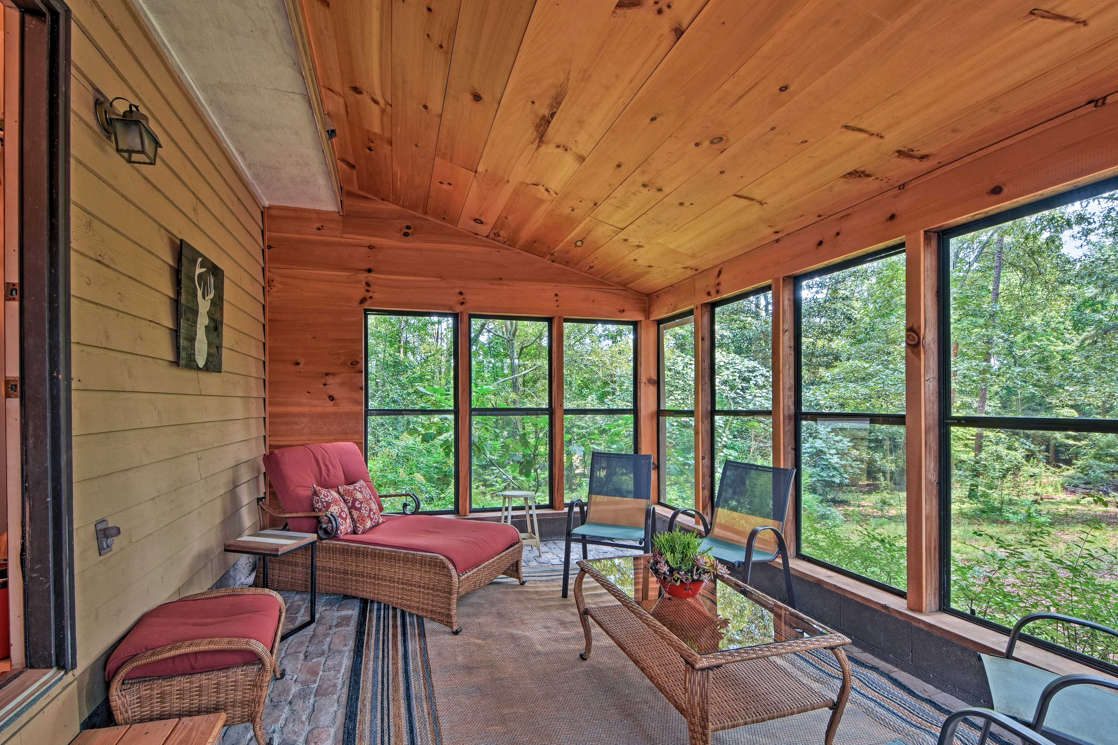 Curl up with a good book in the comfortable sunroom.