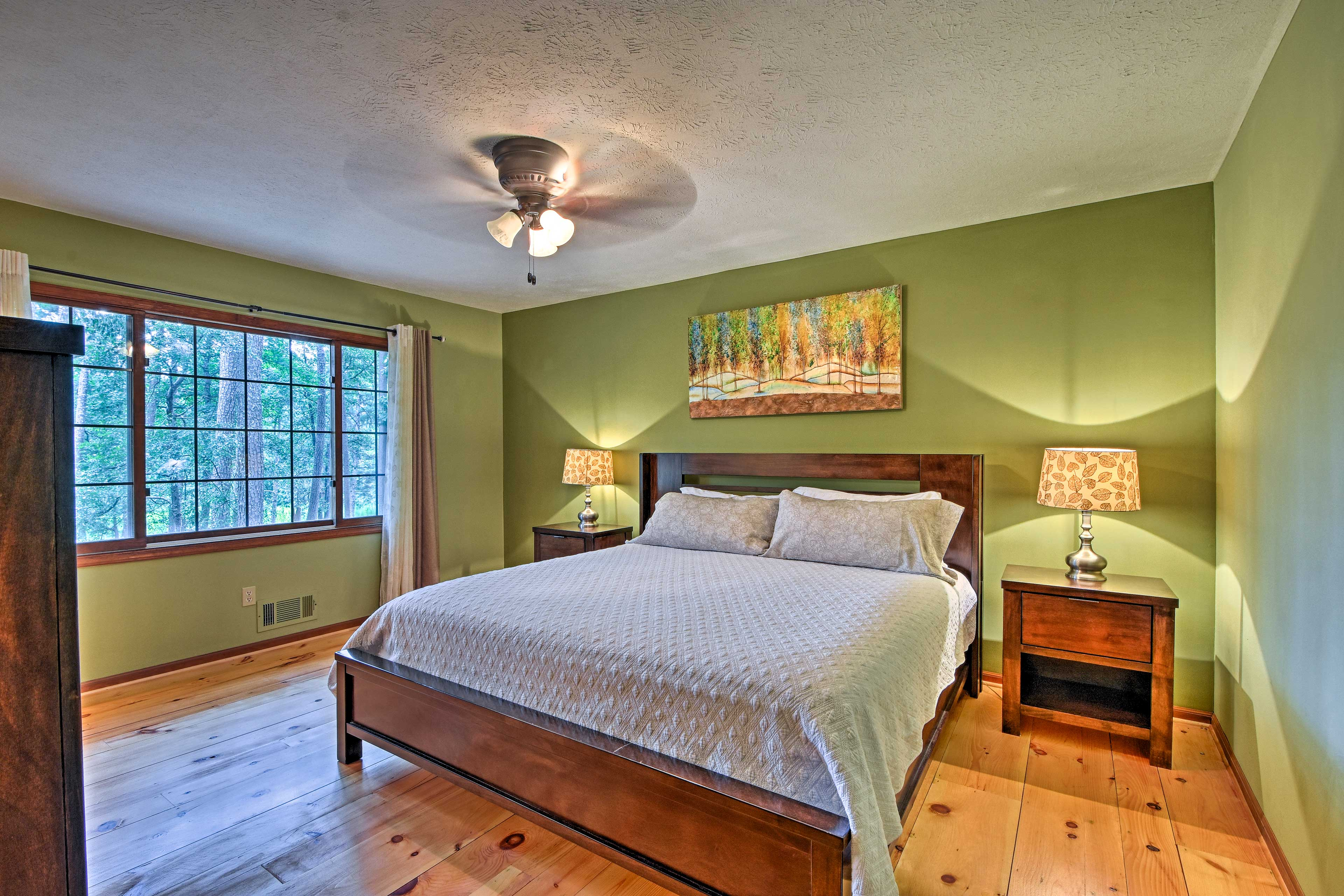 Upstairs, this tranquil bedroom boasts a king bed.