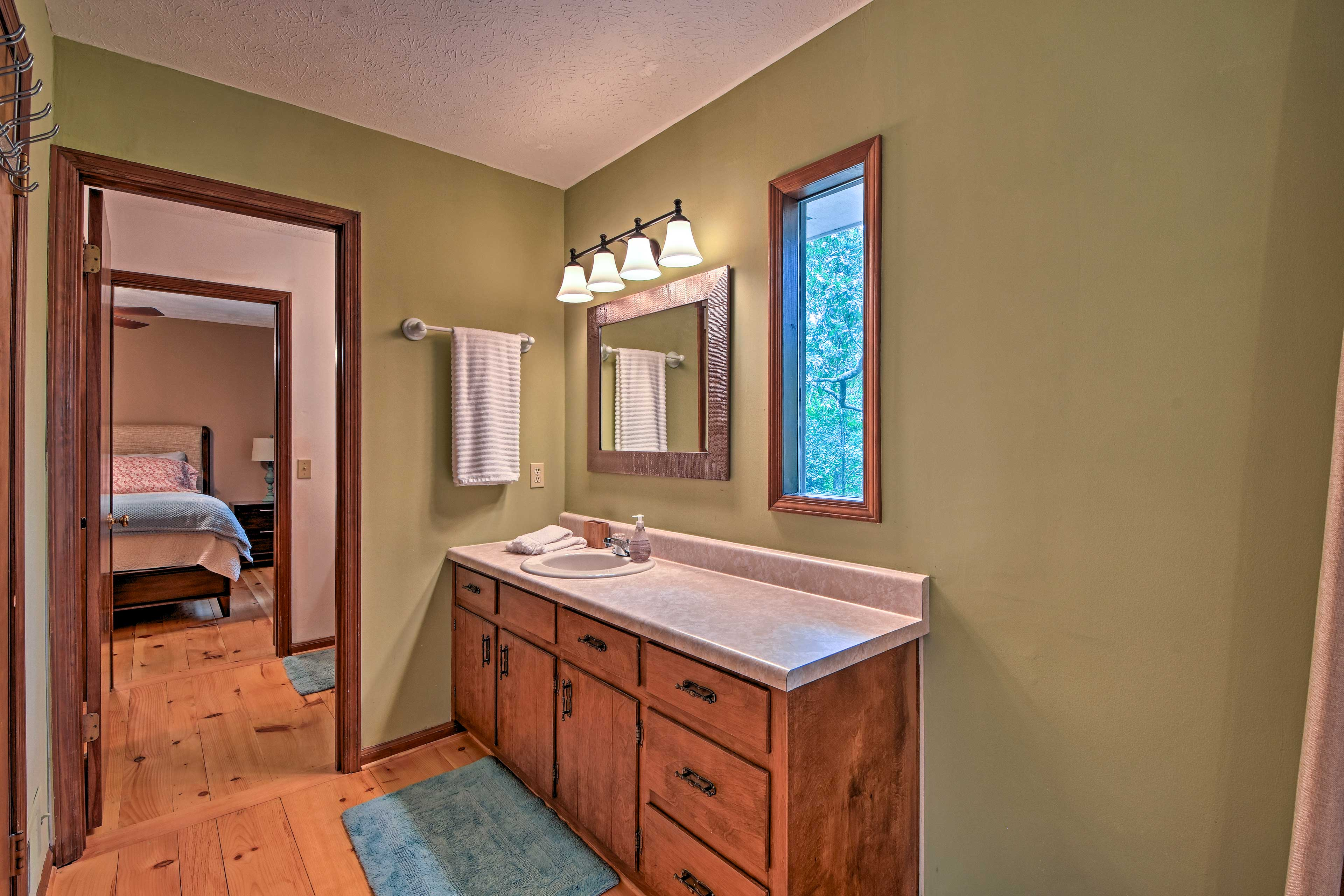 The bedroom is equipped with its own sink and vanity.