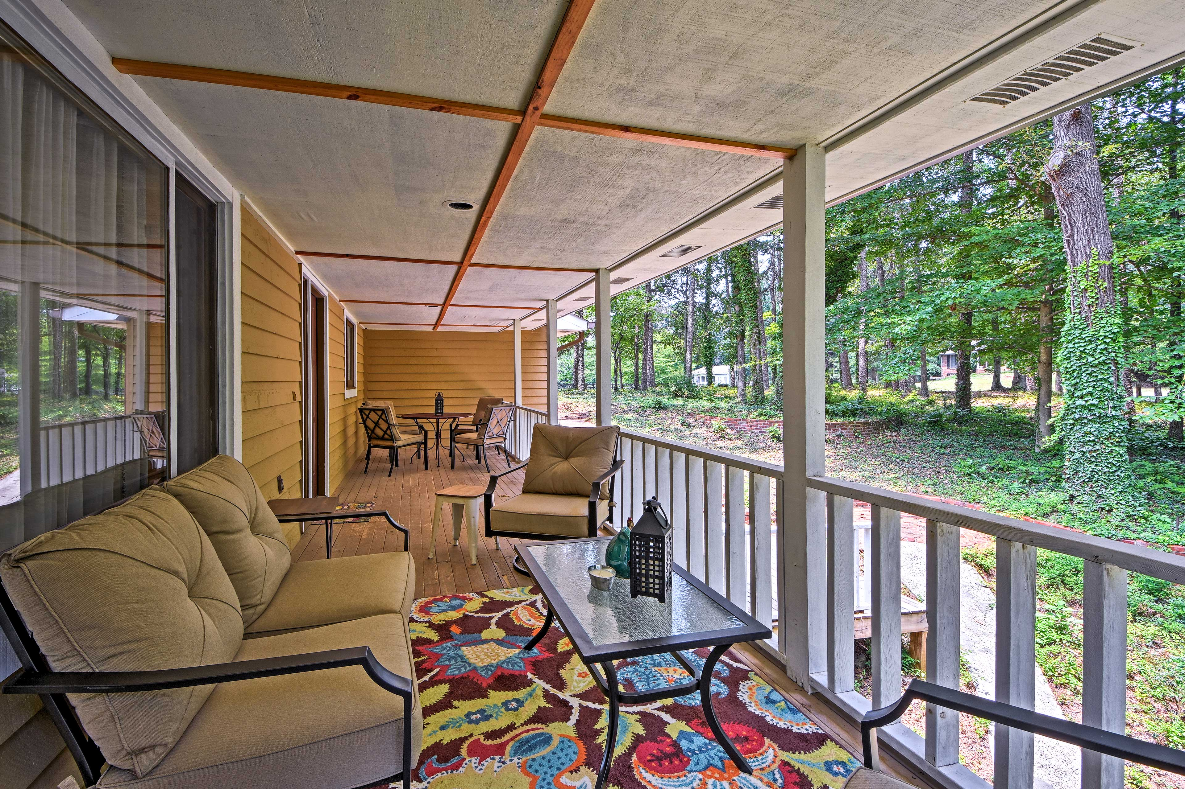 Padded seating furnishes the expansive front porch.