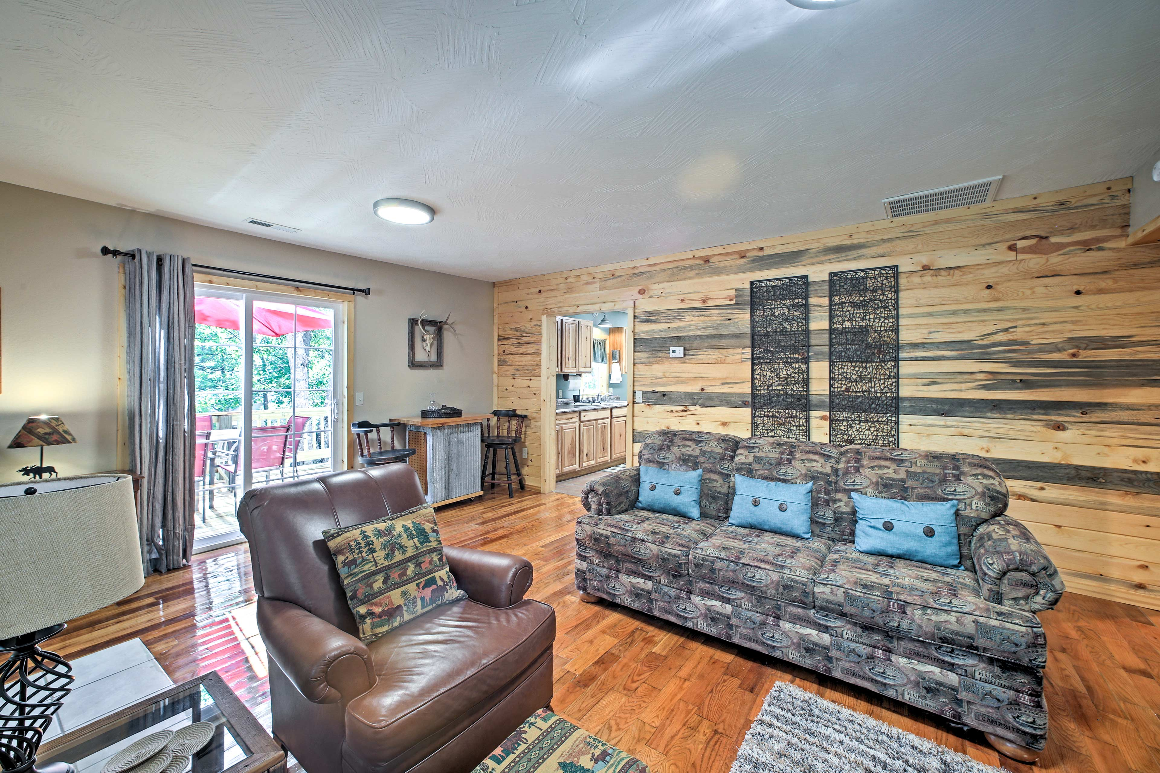 The wood paneled wall is a lovely accent to the already cozy room.
