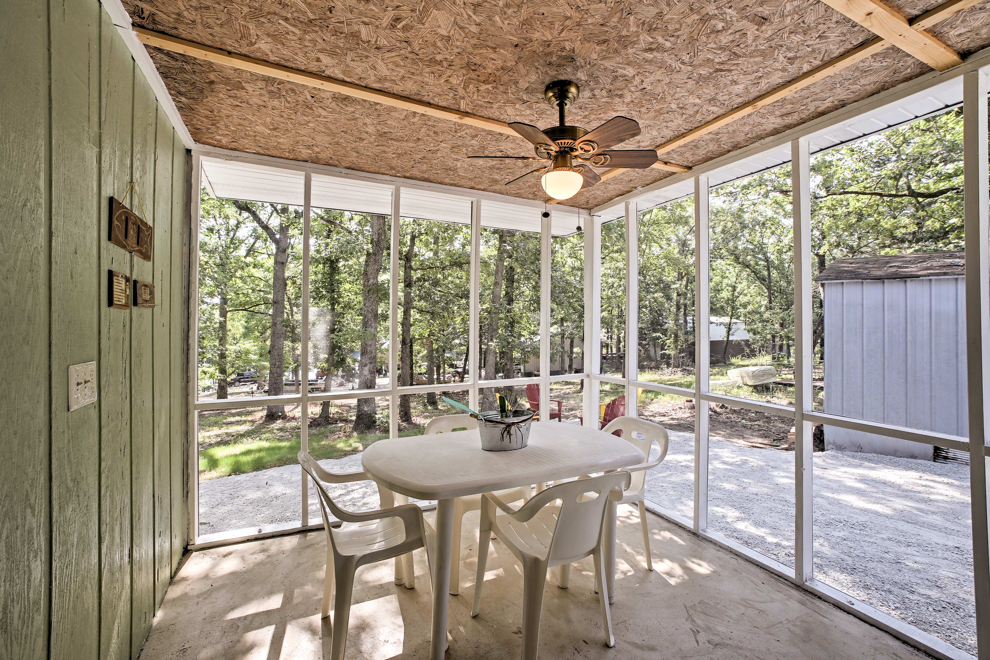 Escape the sun but remain outdoors in the screened-in porch.