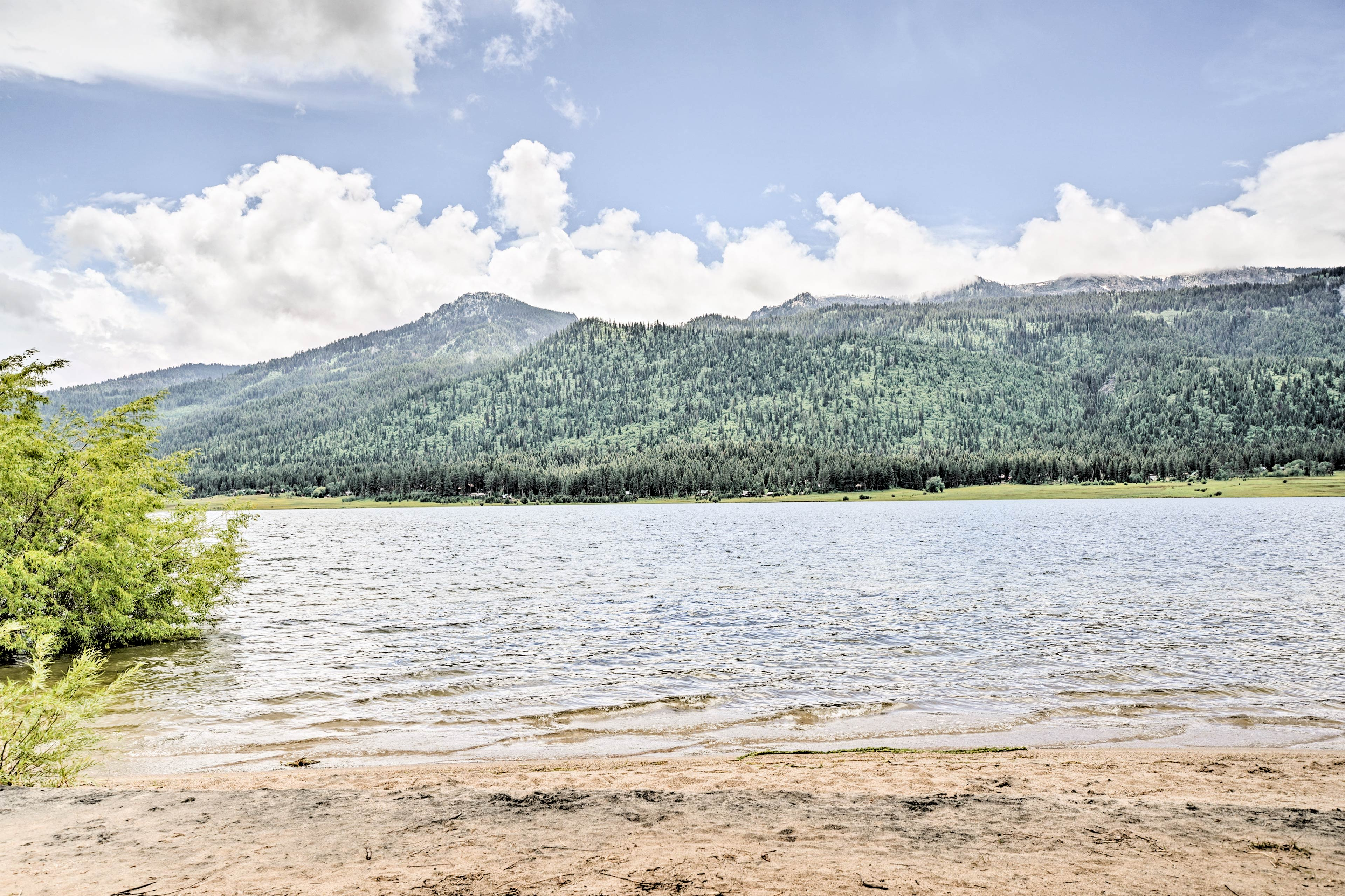 Perfect your sun-kissed tan while sunbathing on the sandy shore of the lake.