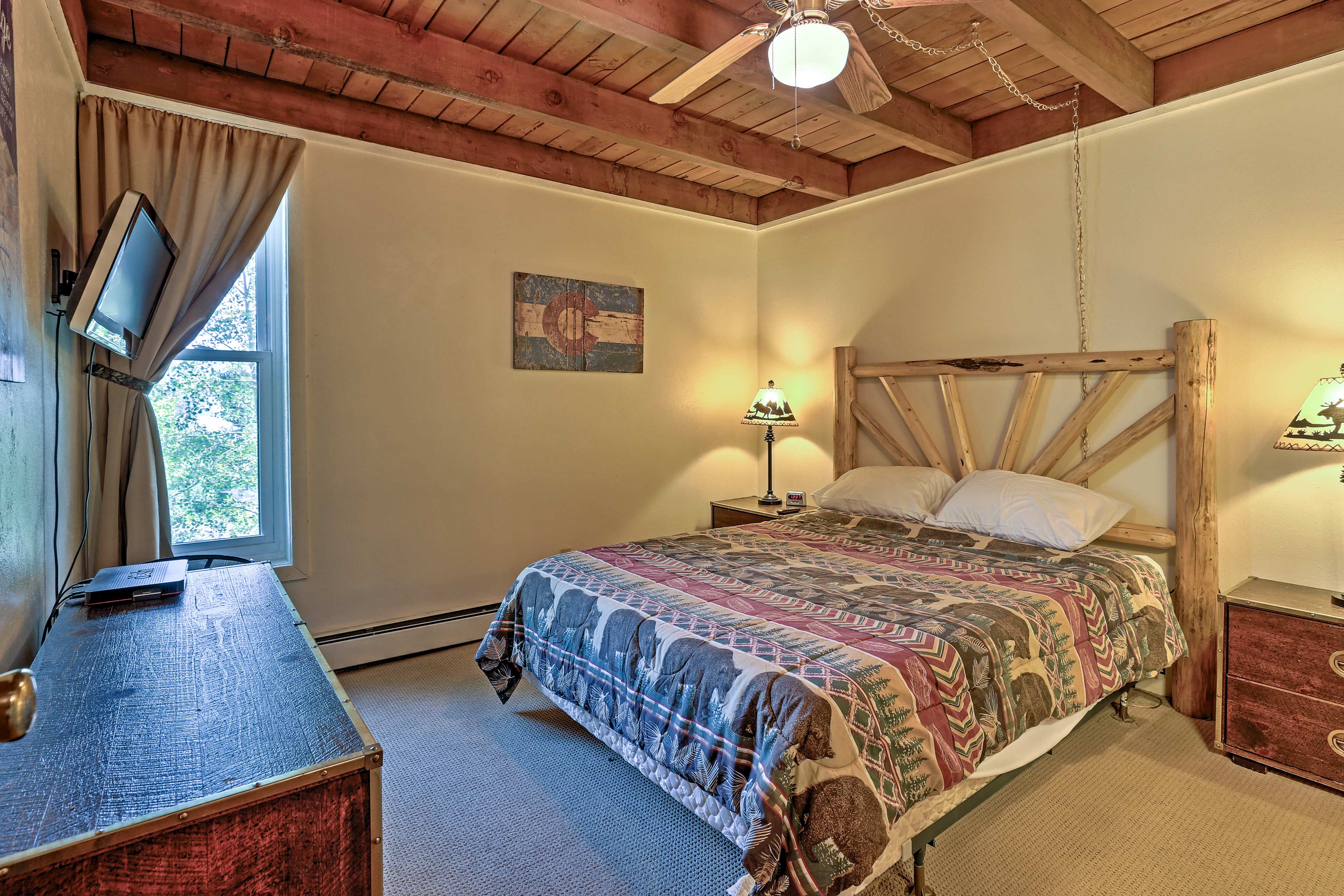 Sink into the cozy queen bed in the first bedroom.