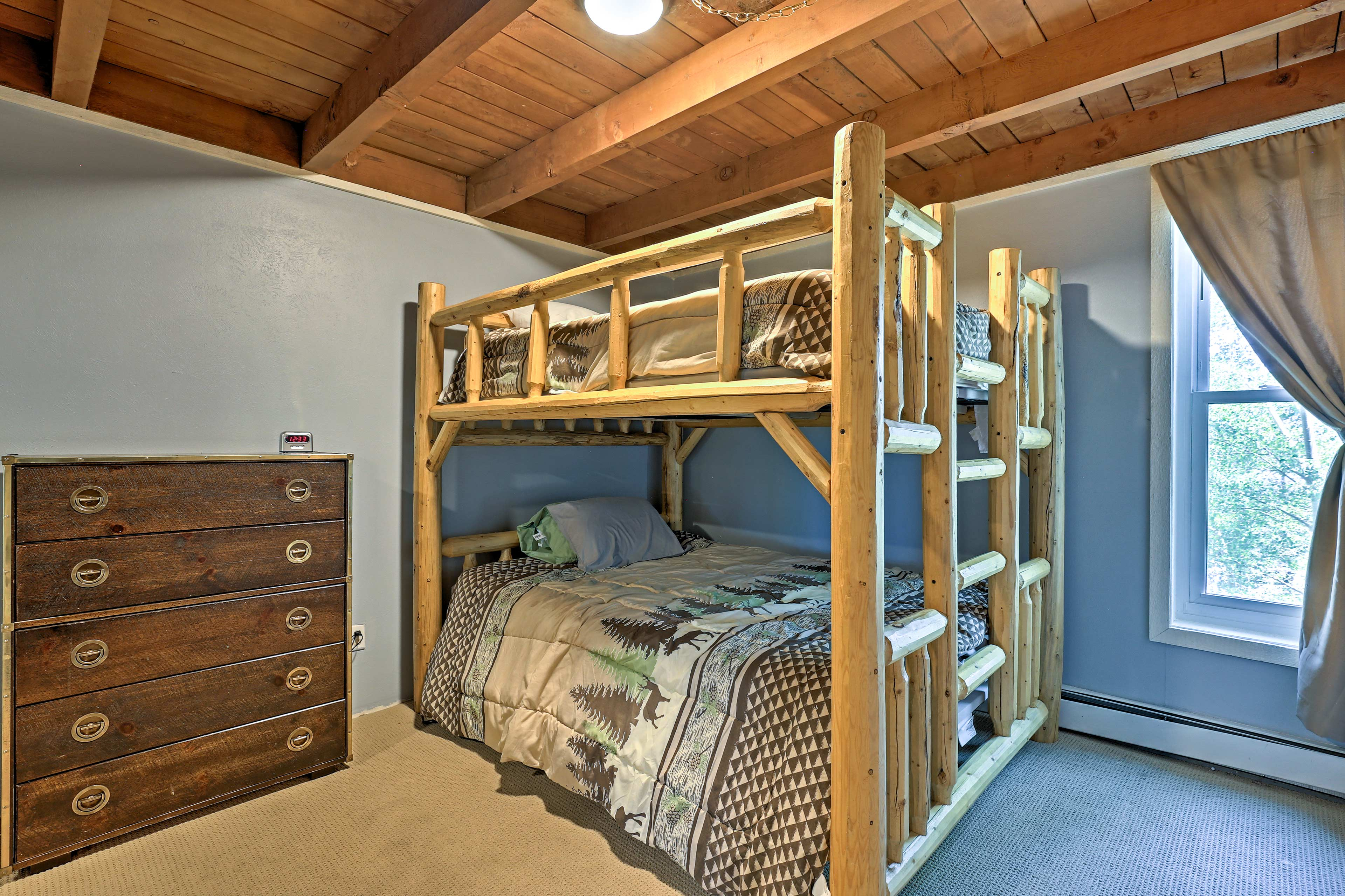Kids or close friends will love the queen-over-queen bunk bed in this room!