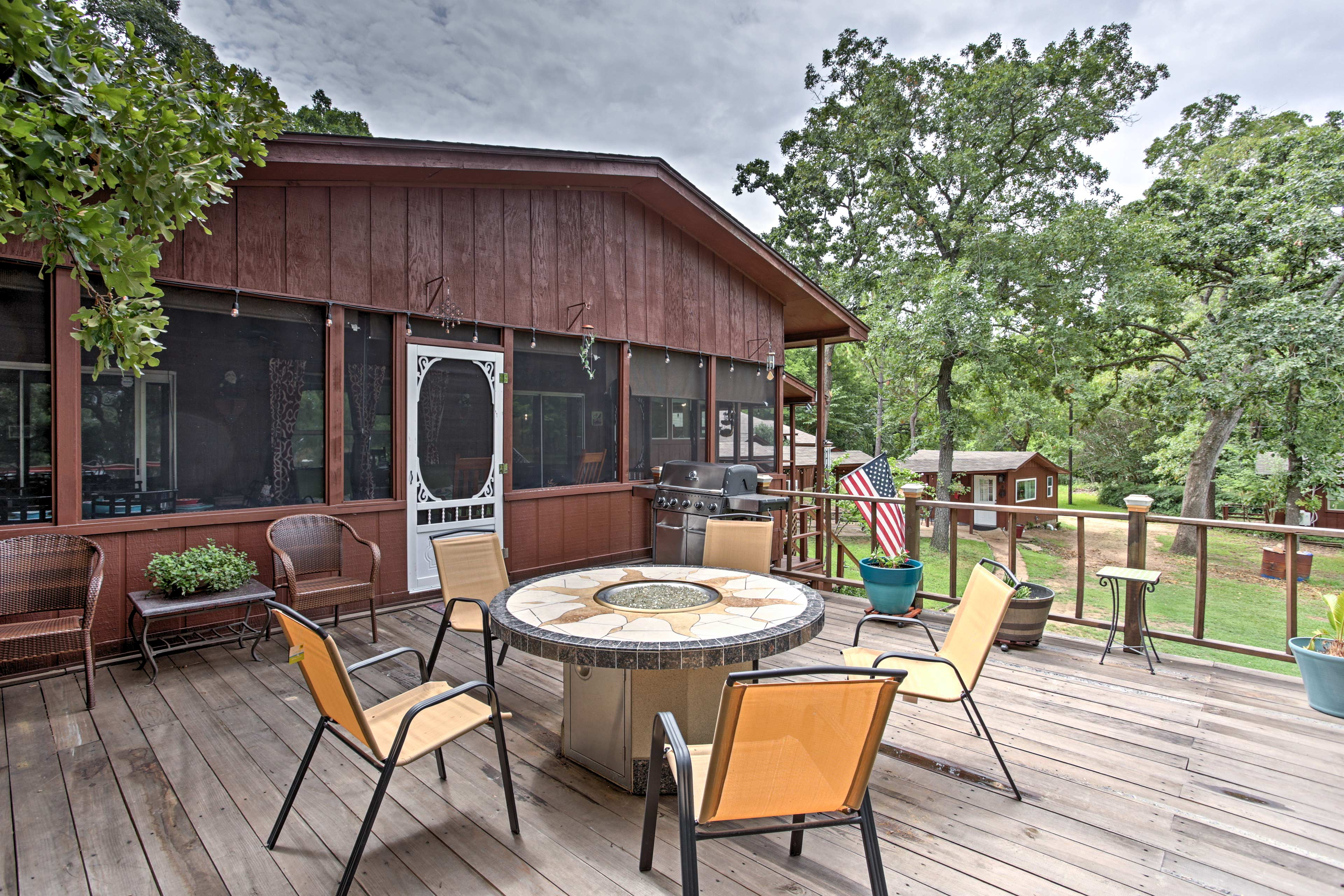 Enjoy evenings around the fire pit on the spacious deck.