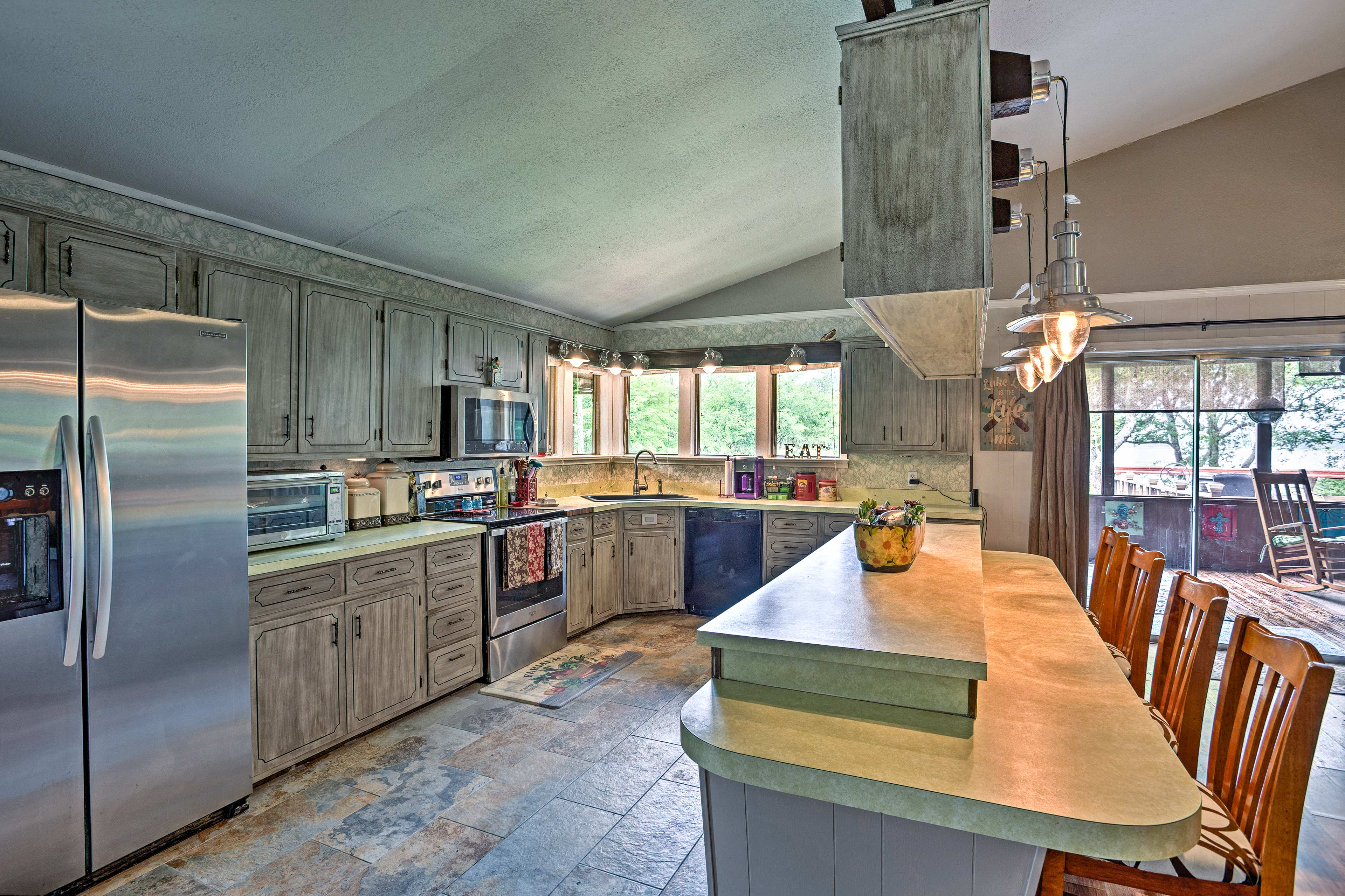 Beautifully stained cabinets complement the gleaming stainless steel appliances.