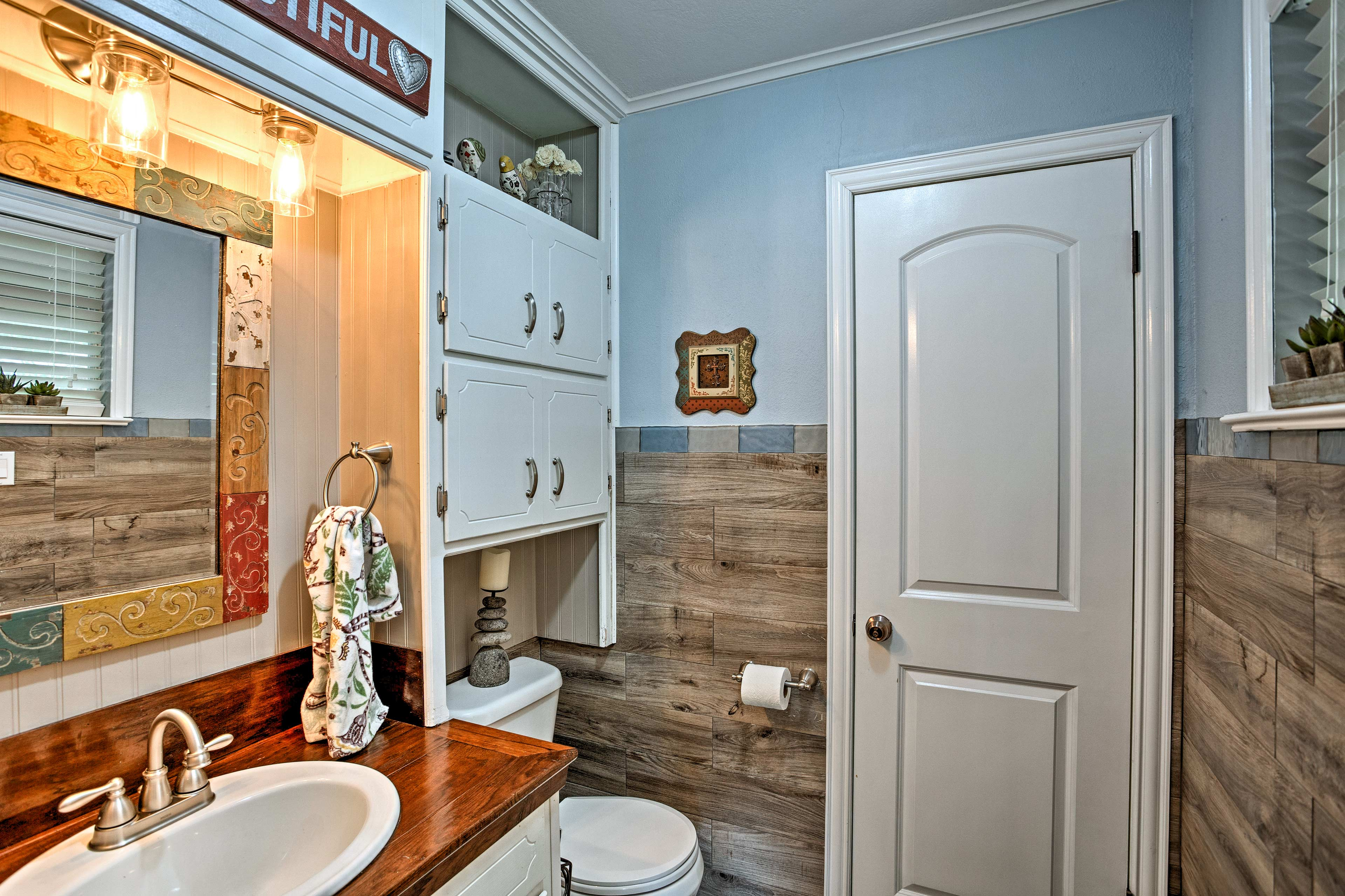 Wood paneling lines the half-bath walls.