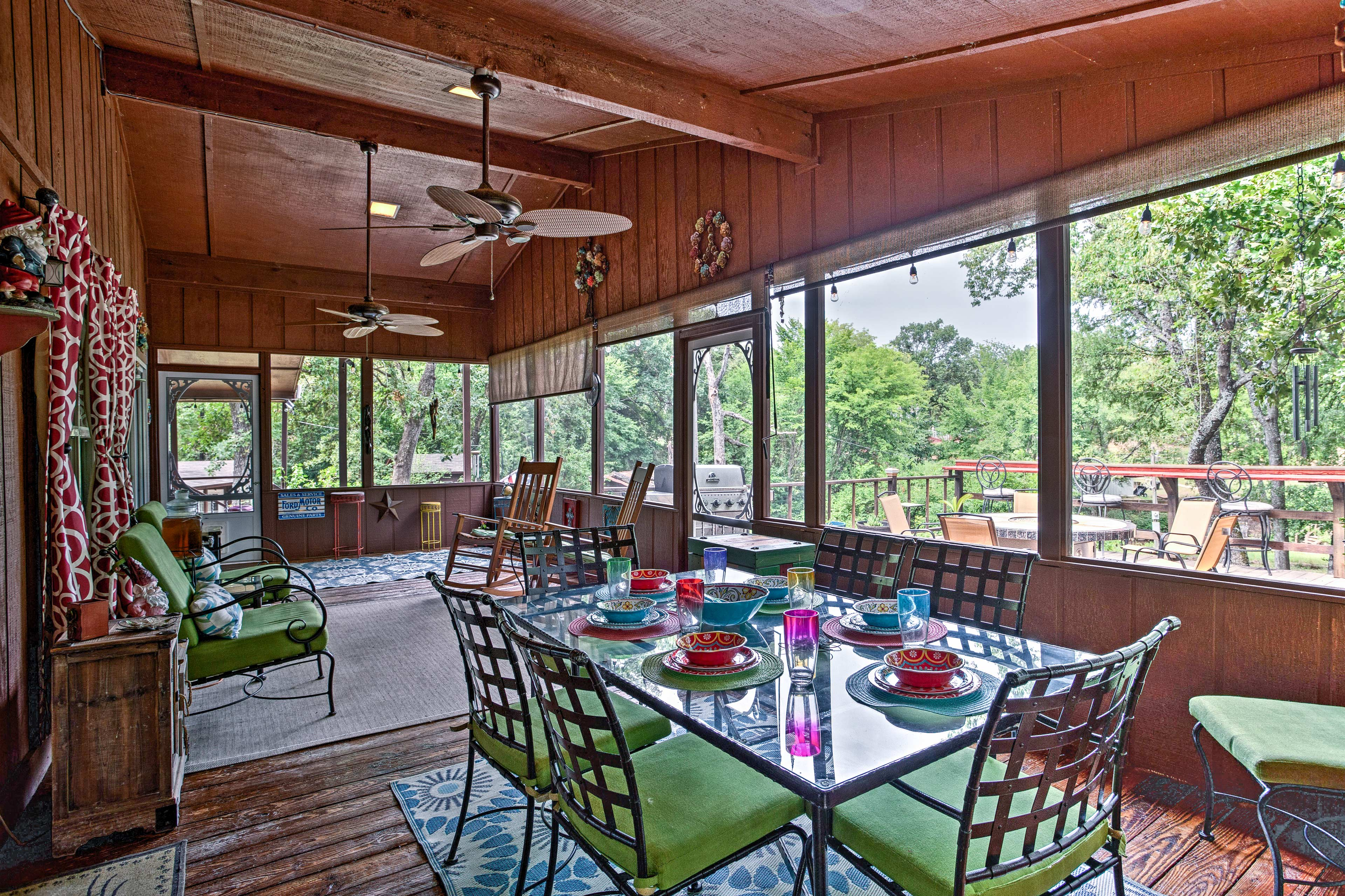 Enjoy the lush, picturesque property through the sunroom's many large windows.