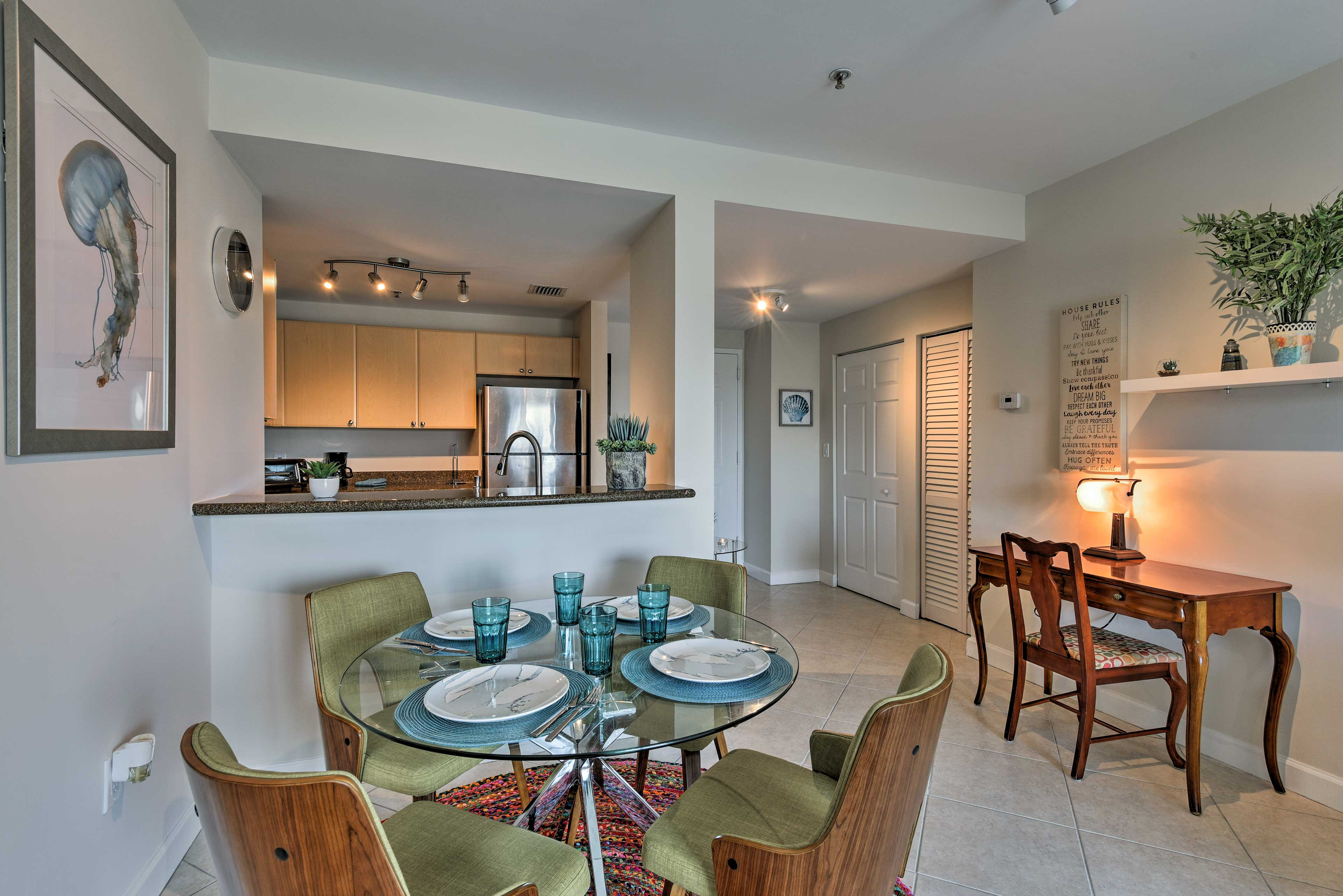 Discuss plans for the day over breakfast at the 4-person dining table.