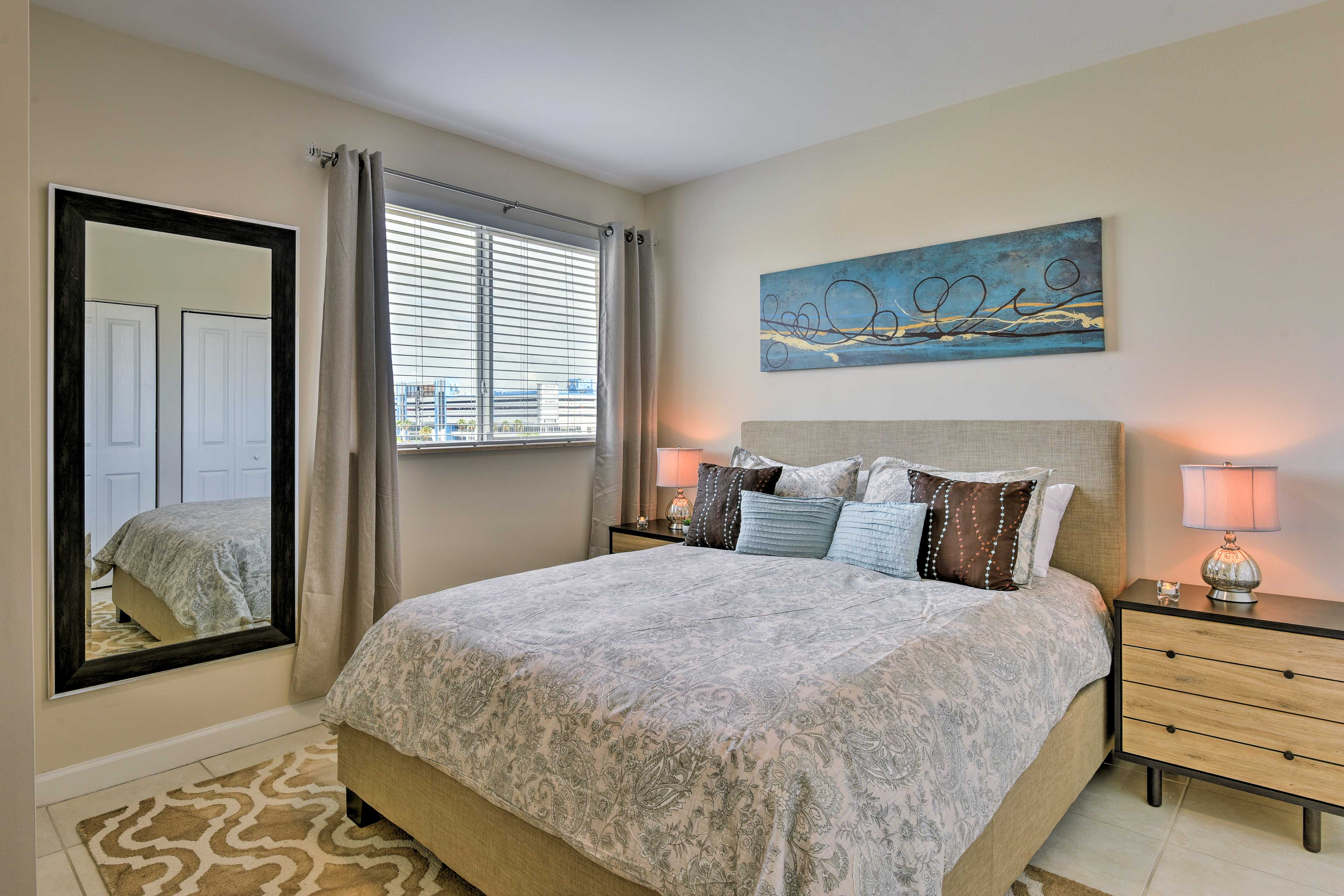 Chic furniture and beautiful artwork highlight the bedroom.