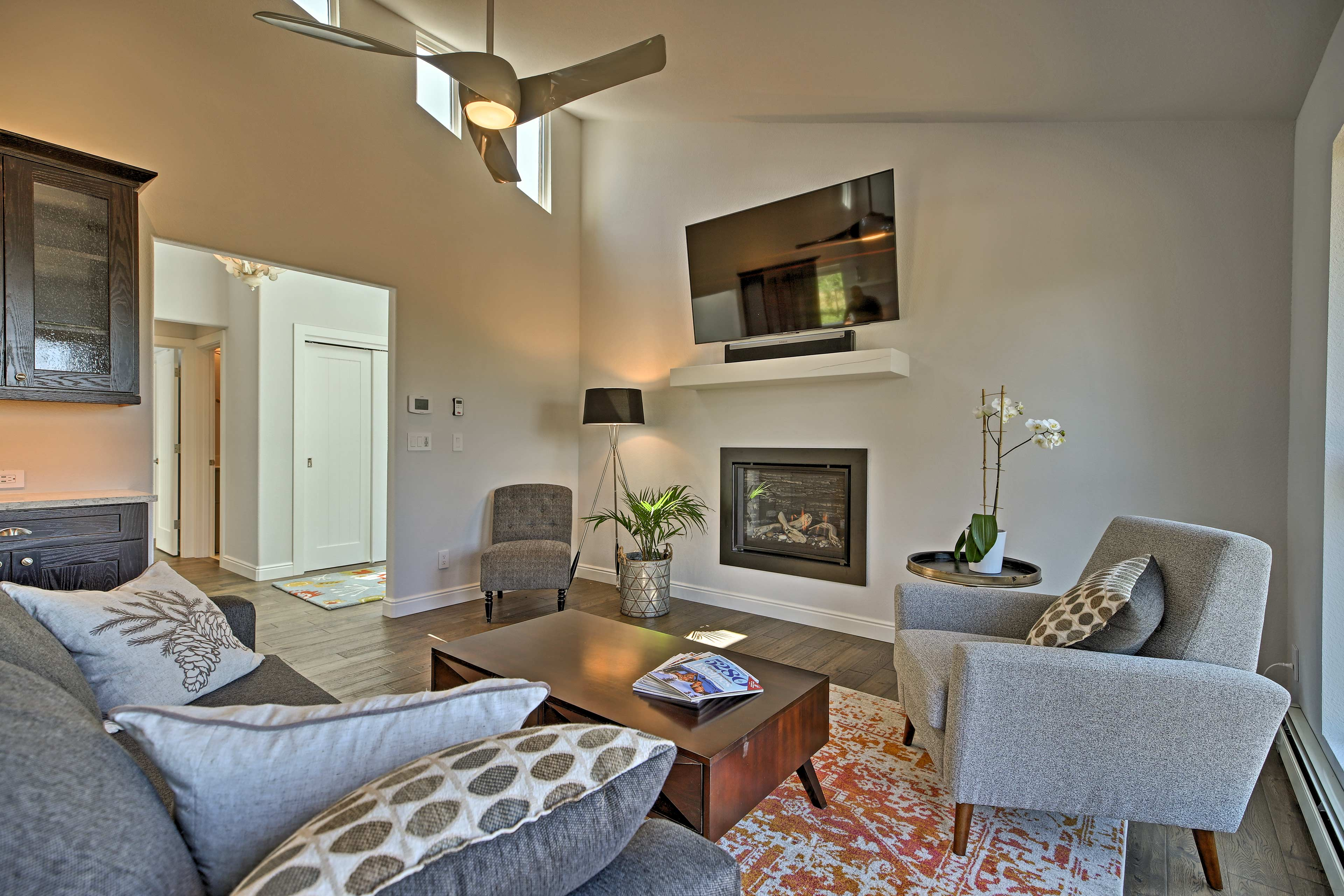 Switch into vacation mode as you sink into the comfortable living room sofa.
