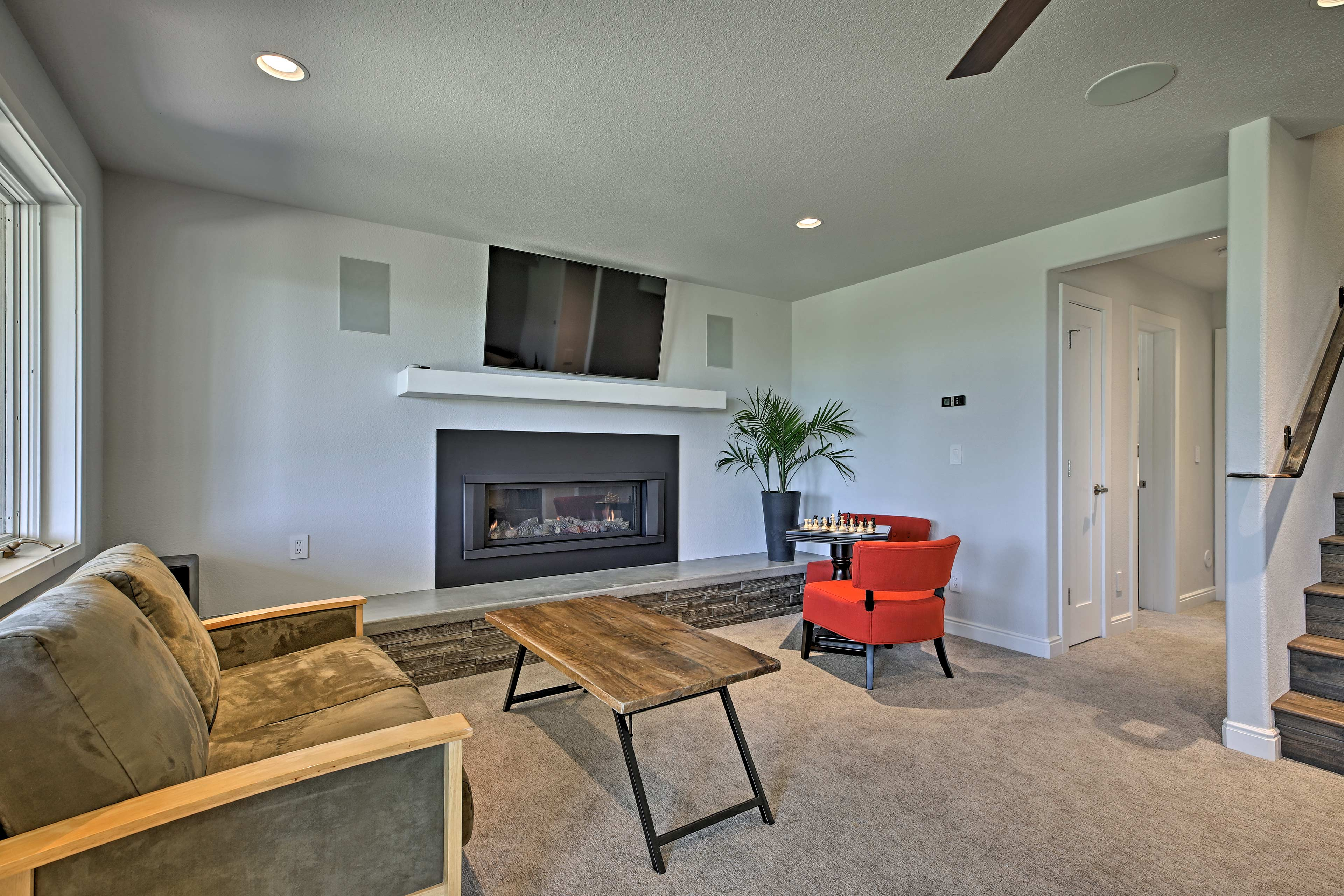 Turn on the remote-controlled fireplace to heat up the lower living room!