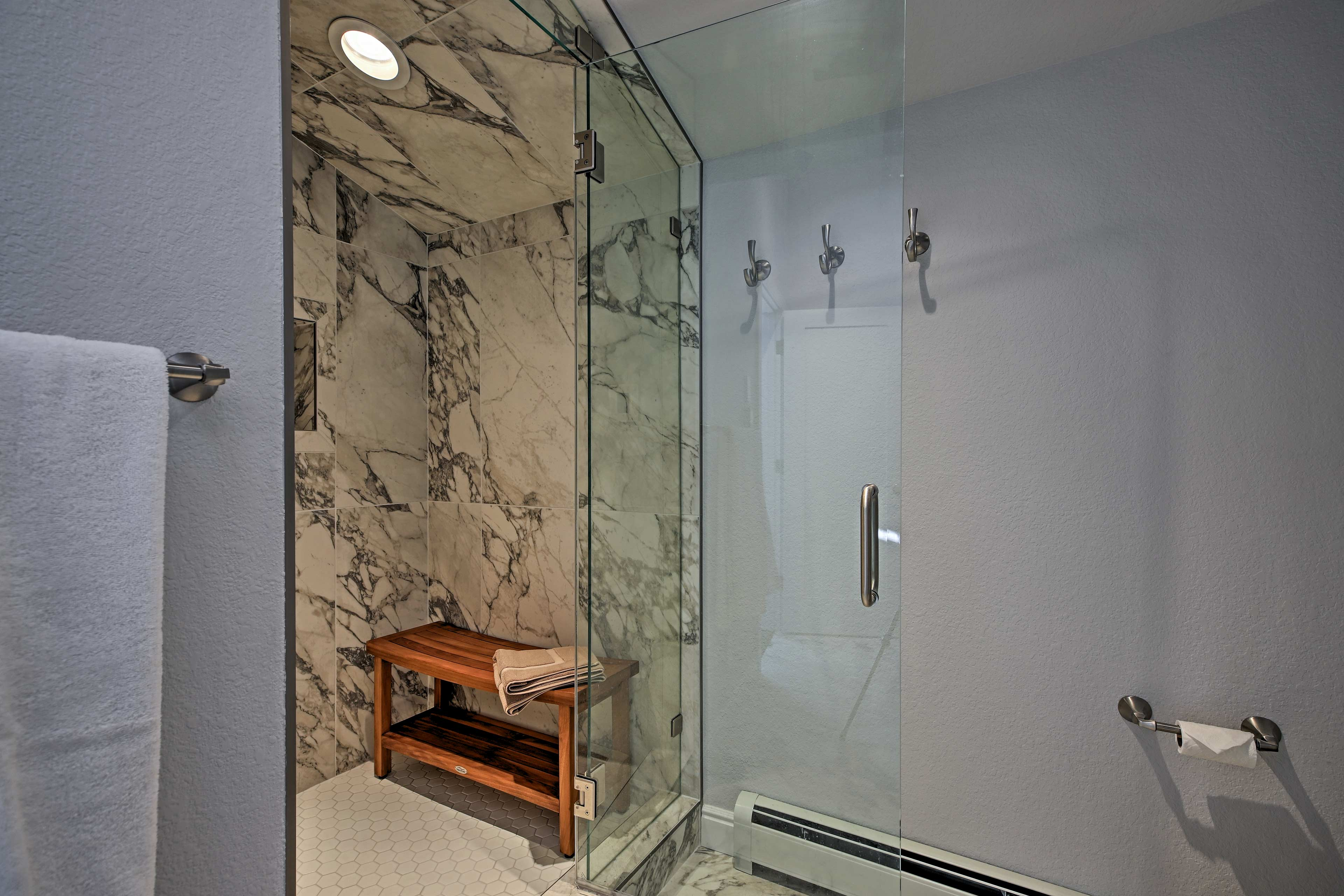 Rinse off in the marble-lined stand-up shower.
