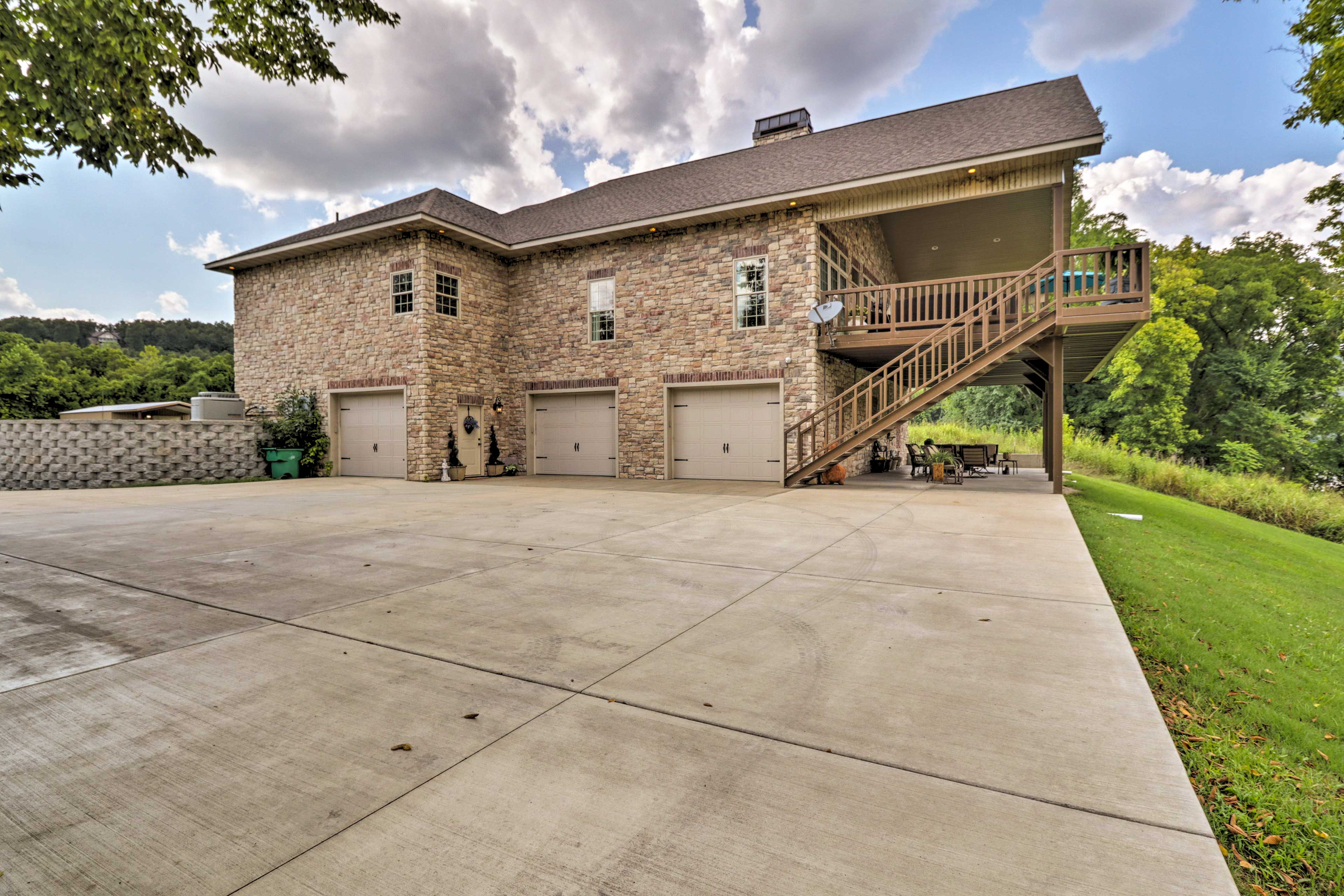 The lower patio offers even more seating and the driveway has plenty of room.