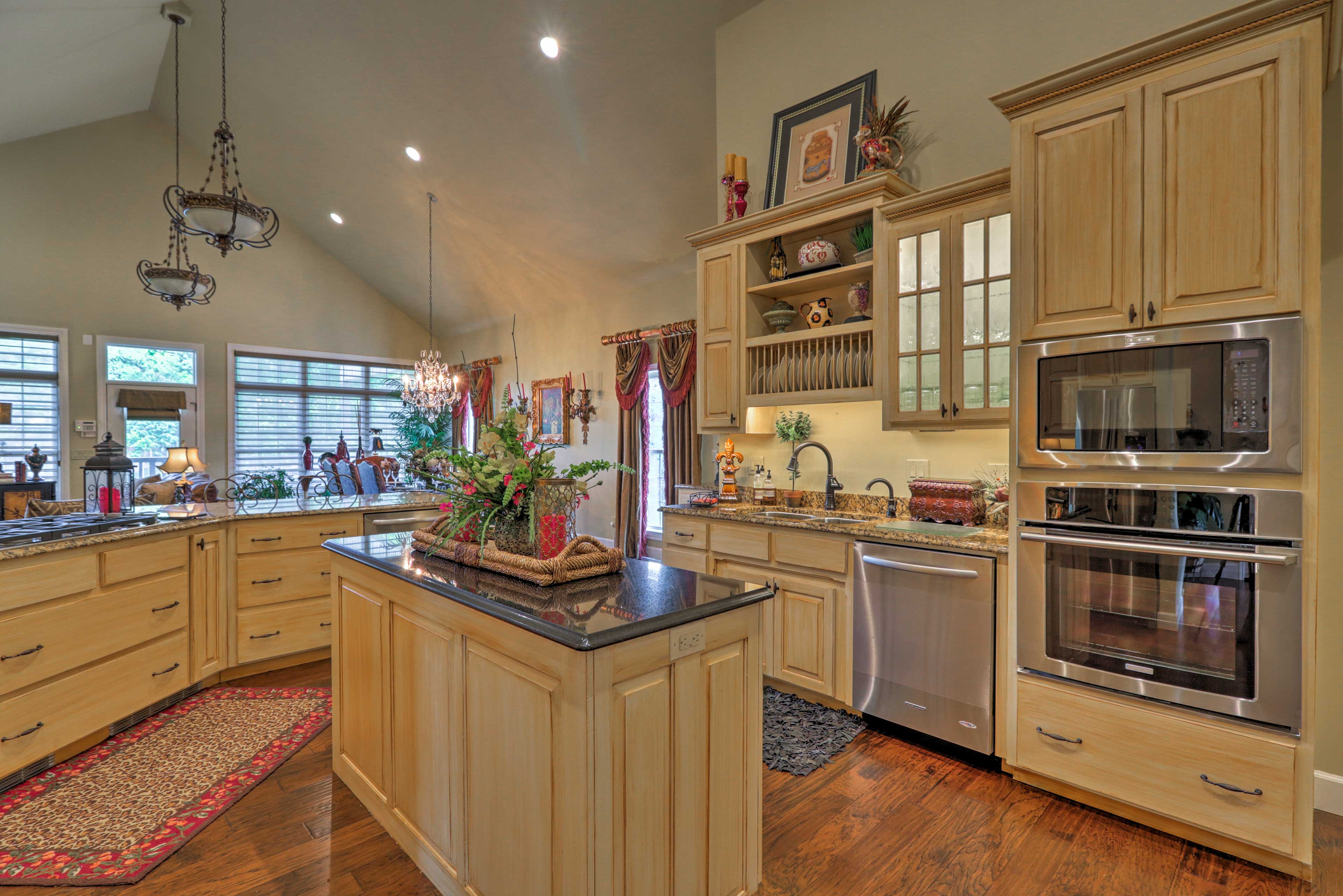 Stainless steel appliances and granite countertops highlight the space.