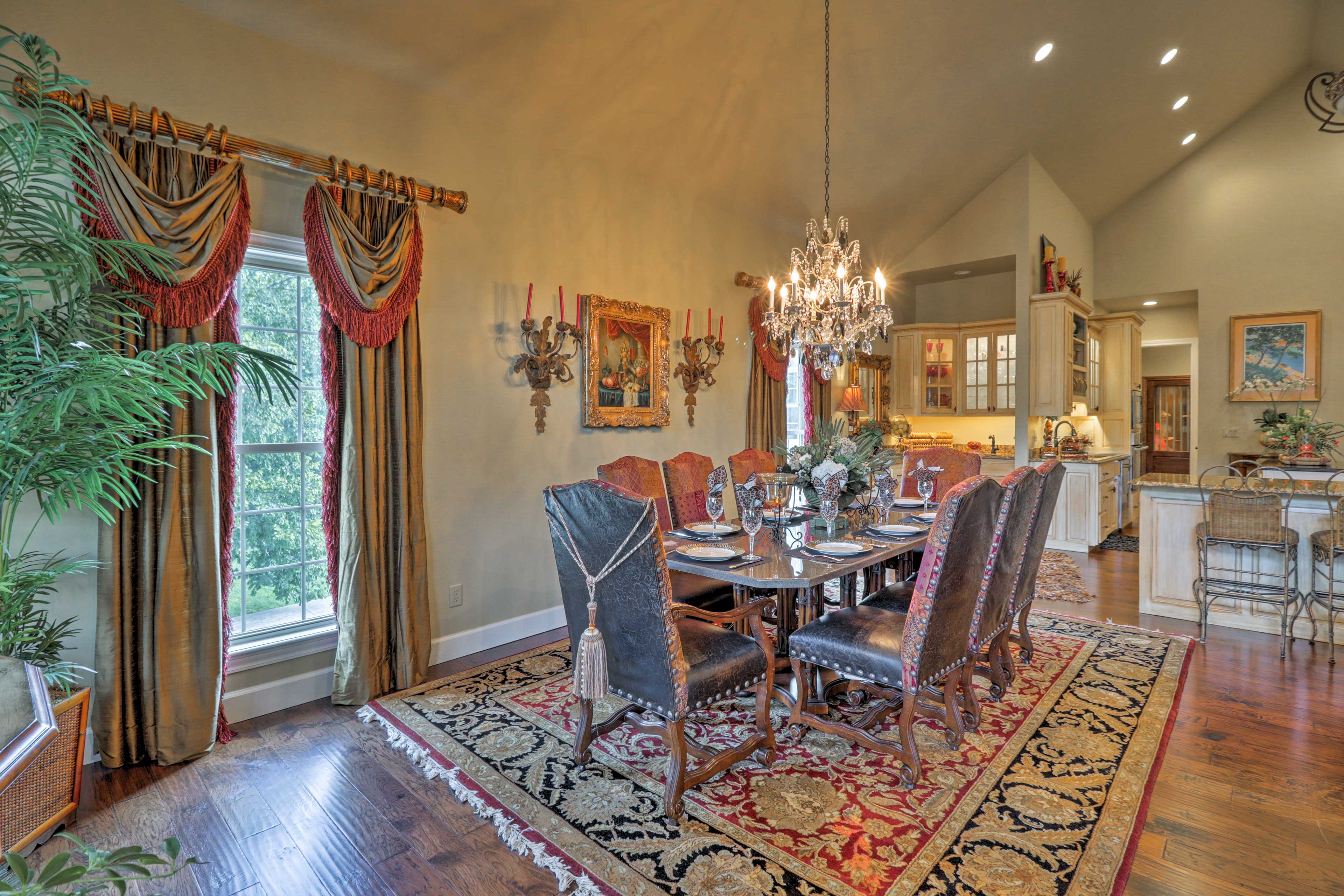 Sit down to a formal dinner at the 8-person table beneath the elegant chandelier