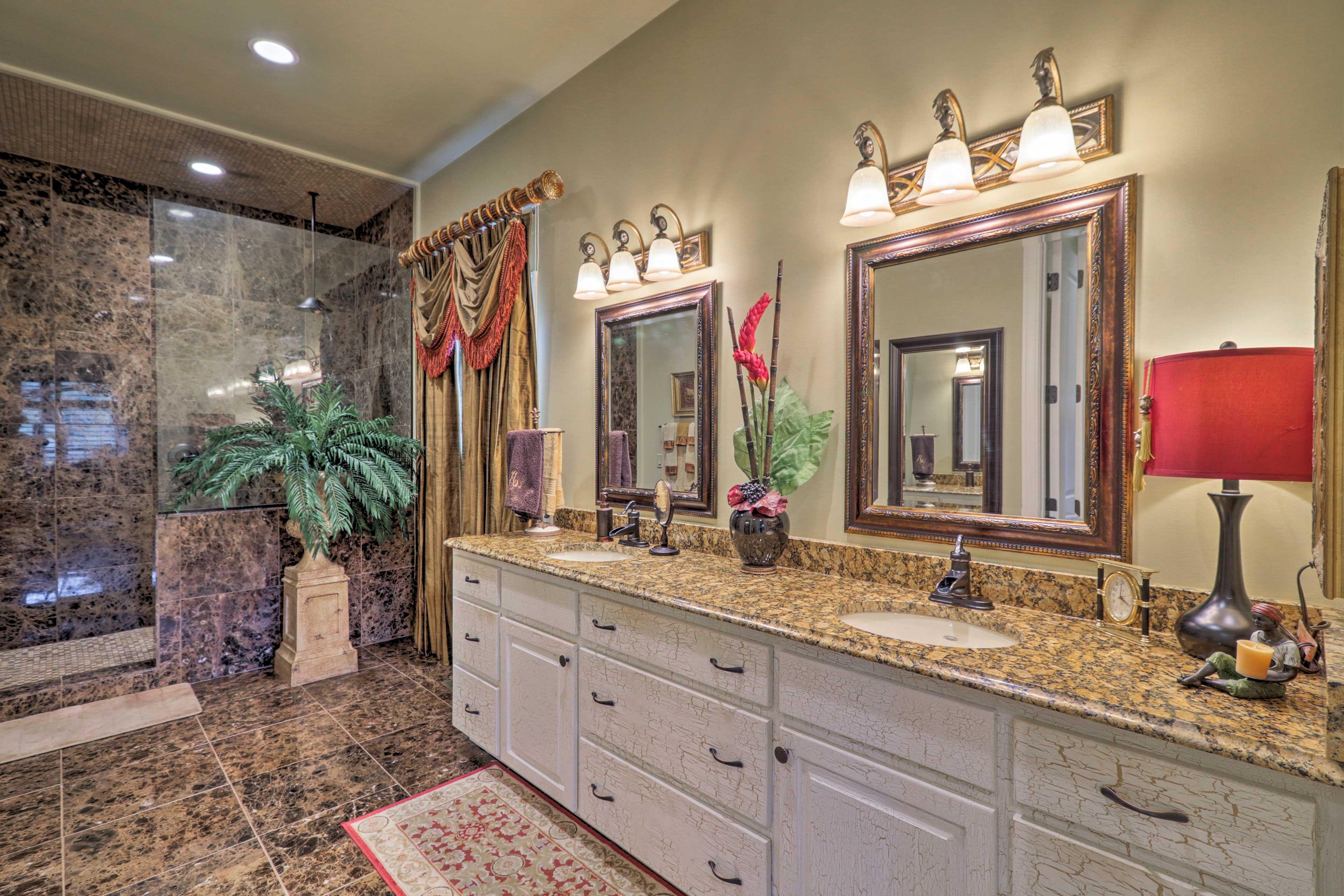 Rinse off in the walk-in shower of the master en-suite bathroom.