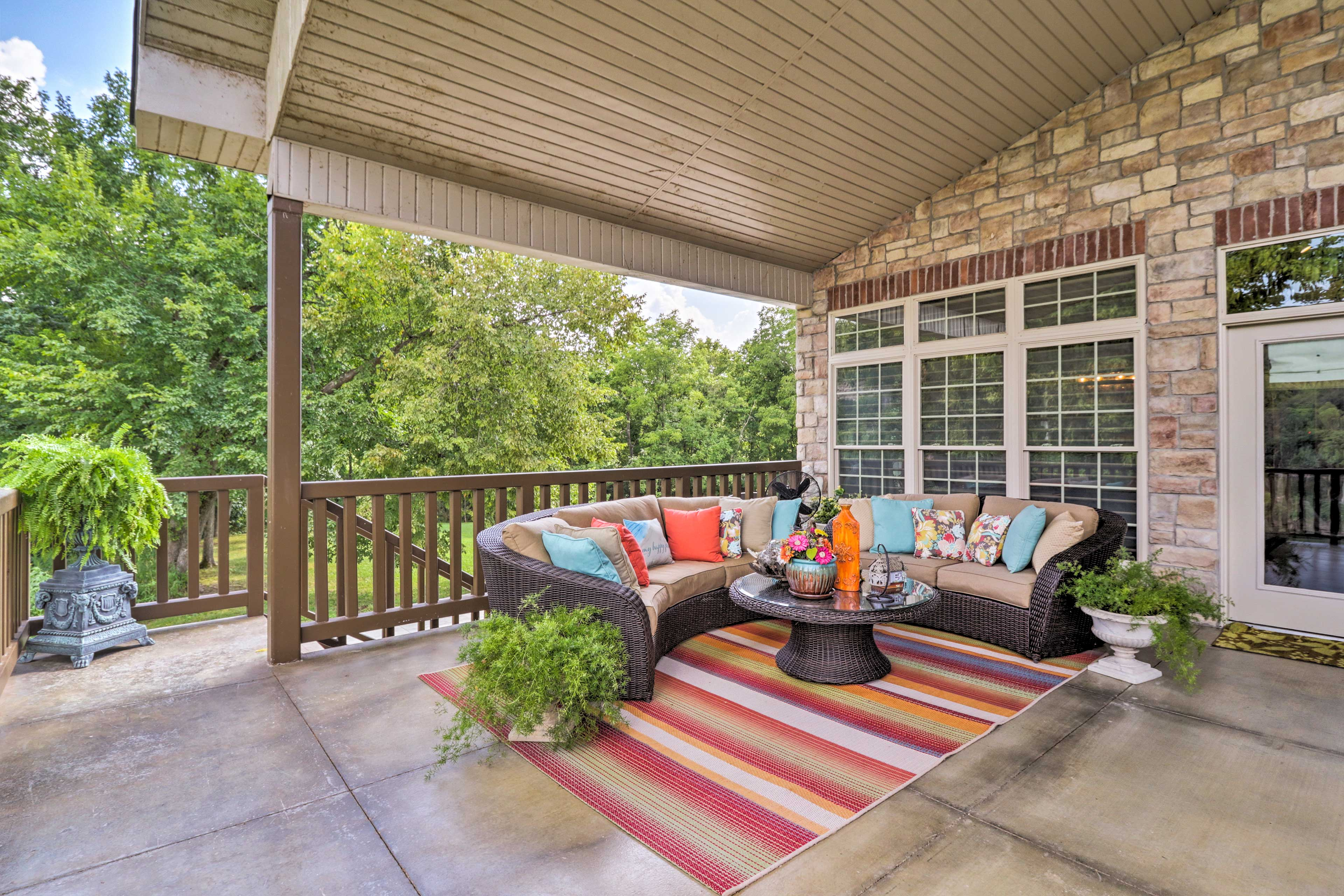 Grab some fresh air while you relax on the wicker furnishings on the deck.