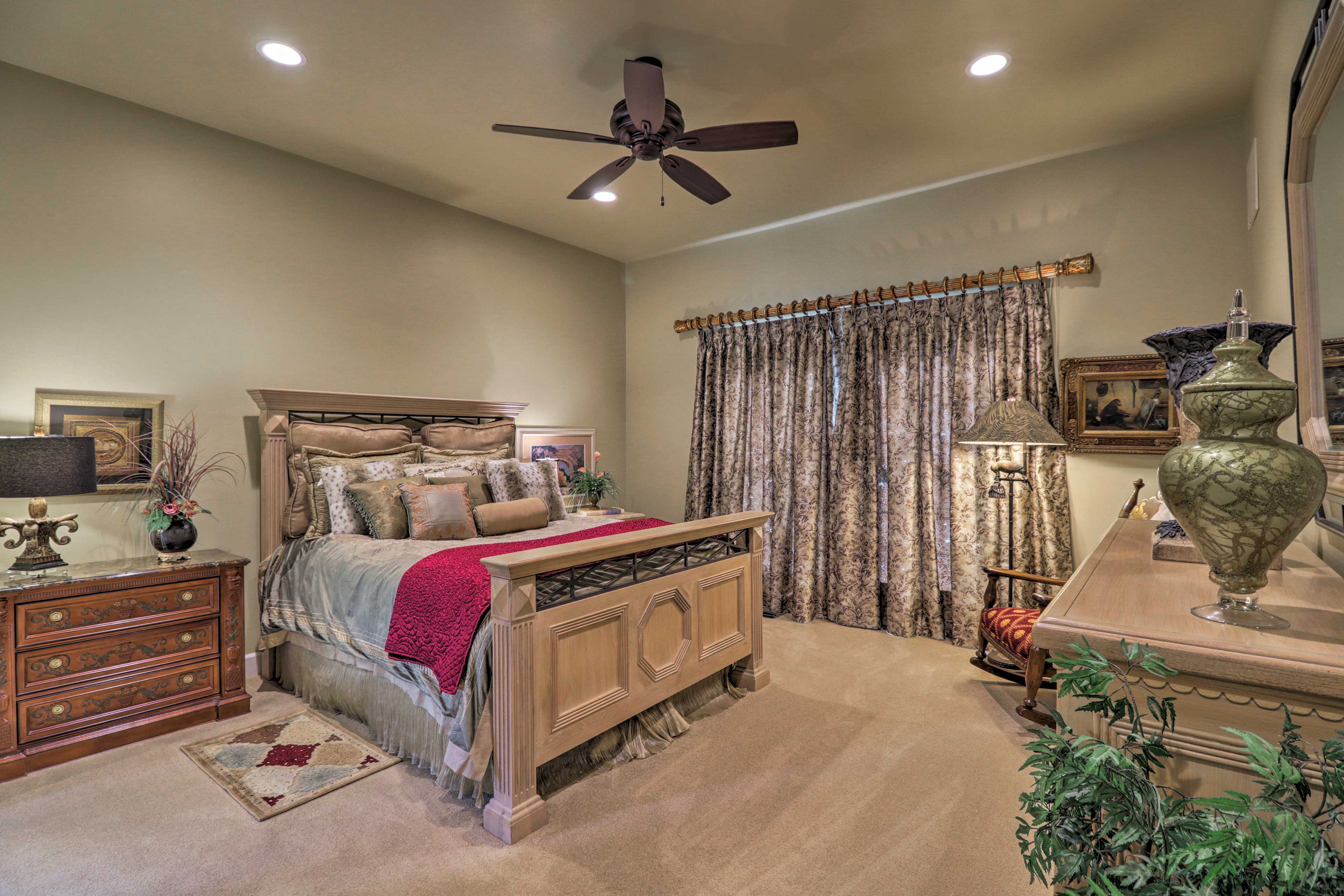 The second bedroom boasts a queen bed and custom draperies & linens.