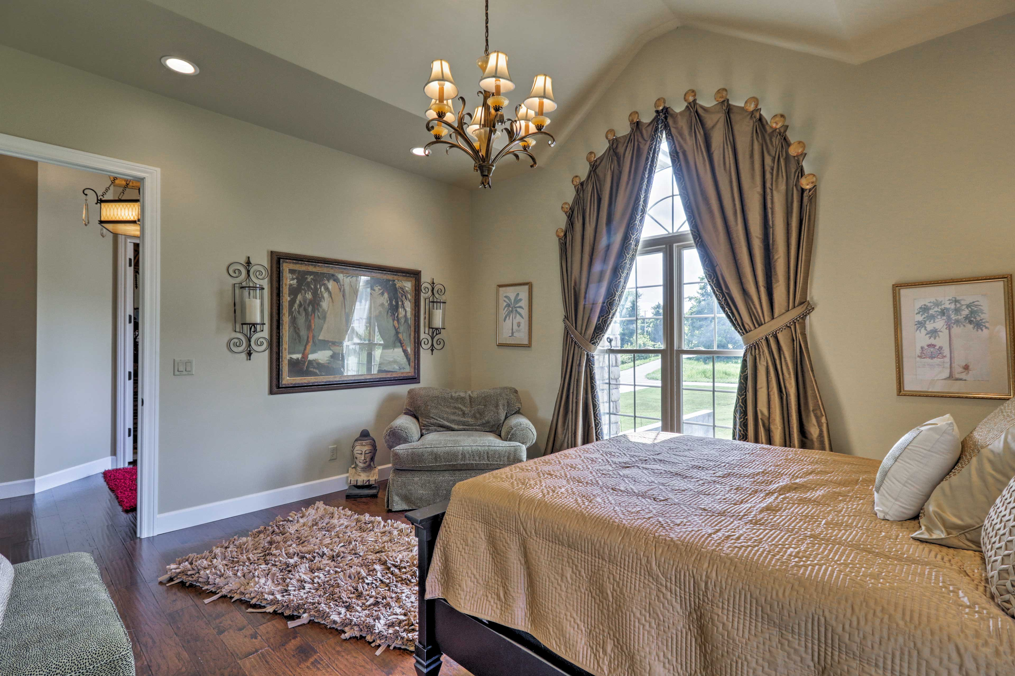 Vaulted ceilings and gorgeous draperies create an opulent atmosphere.