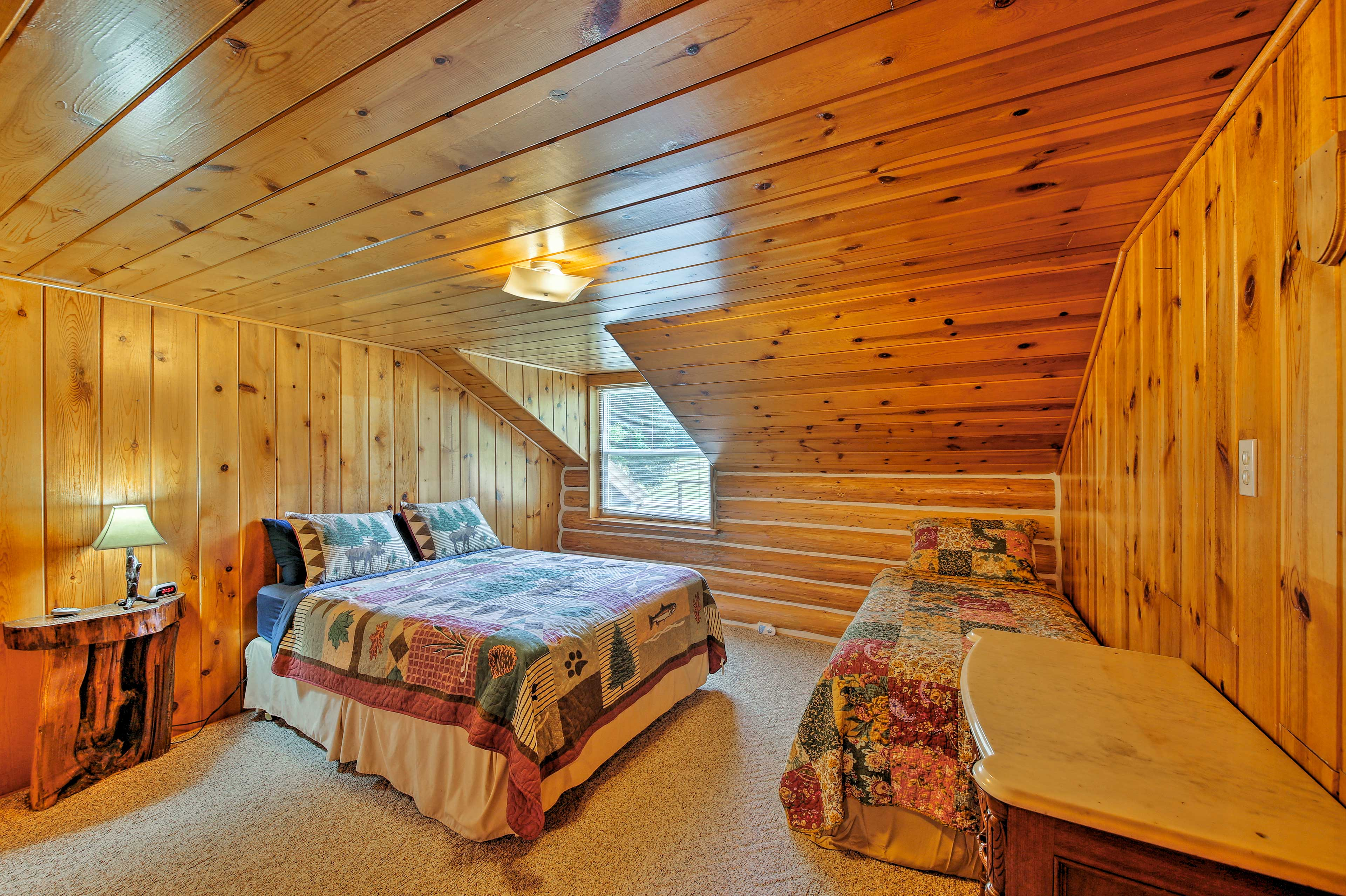 This room features a queen bed and a twin bed.