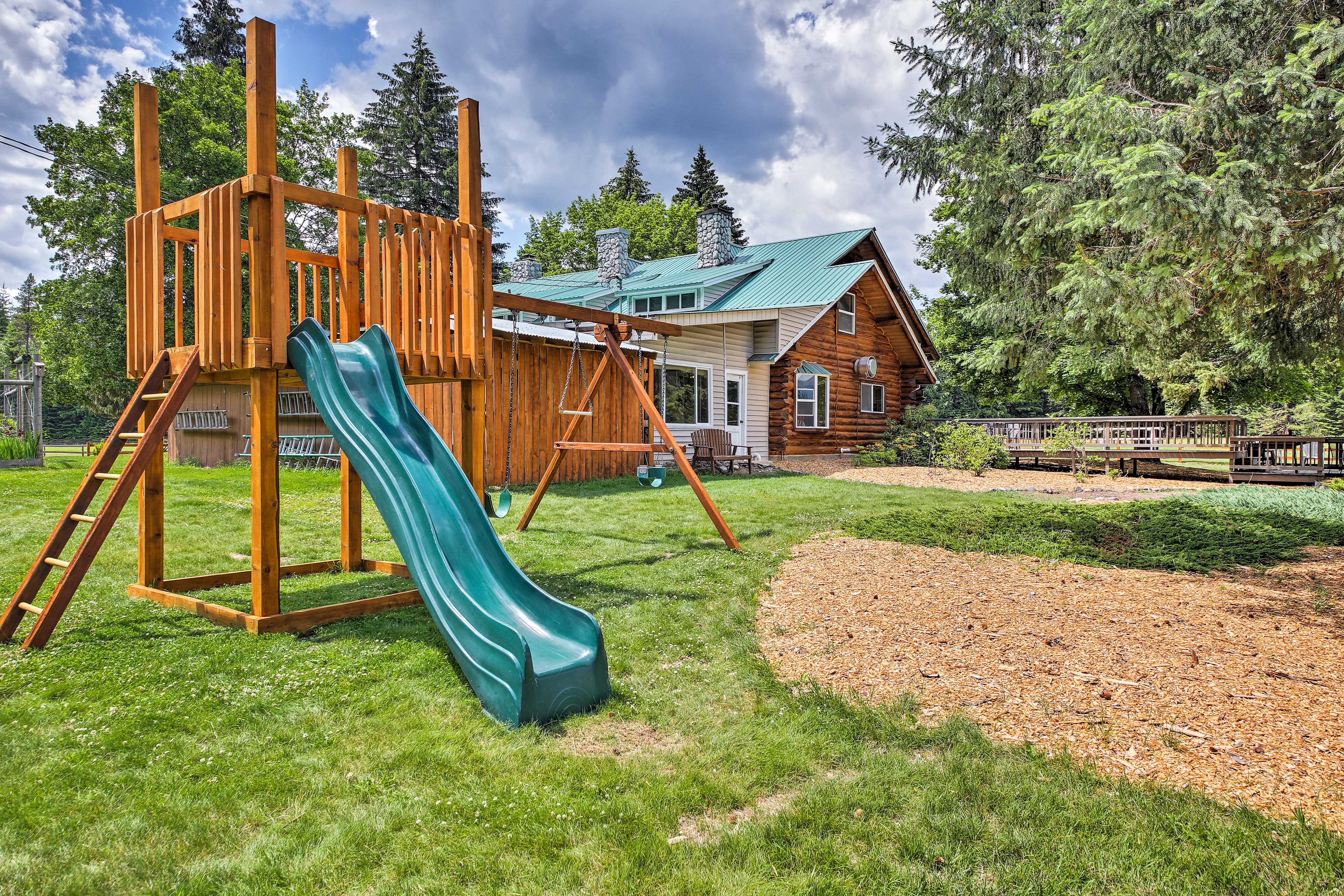 Kids will entertain themselves on this swing set.