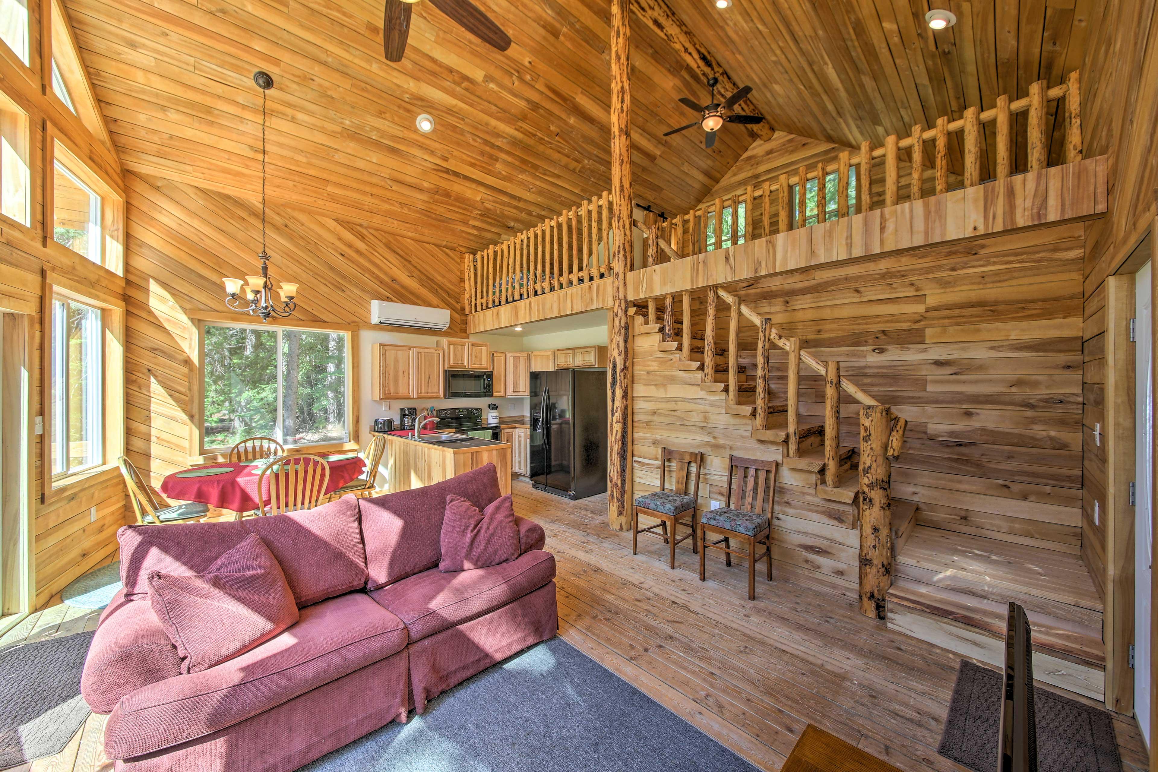 Custom woodwork enhances the log cabin experience.
