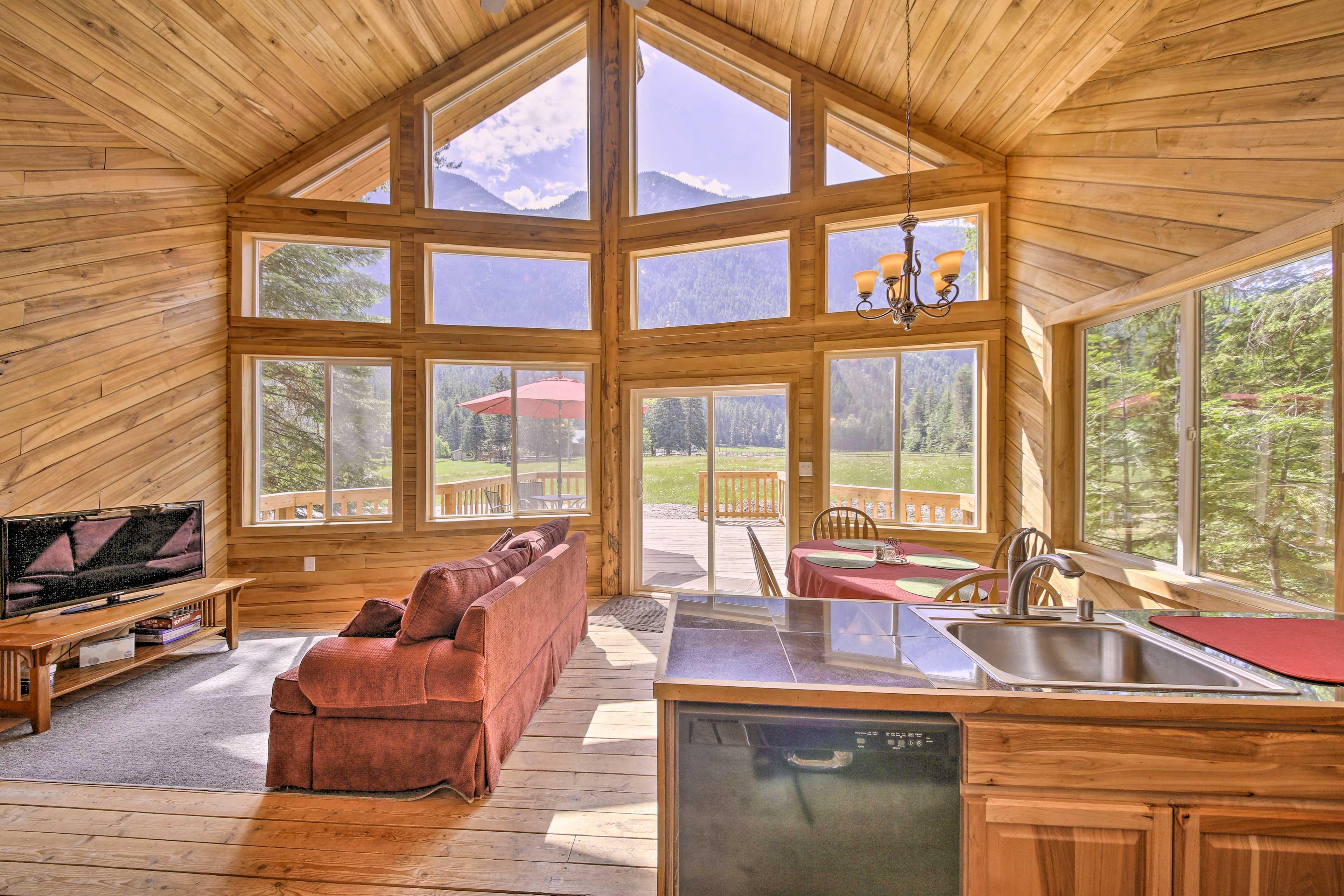 Stunning views await through floor-to-ceiling windows.