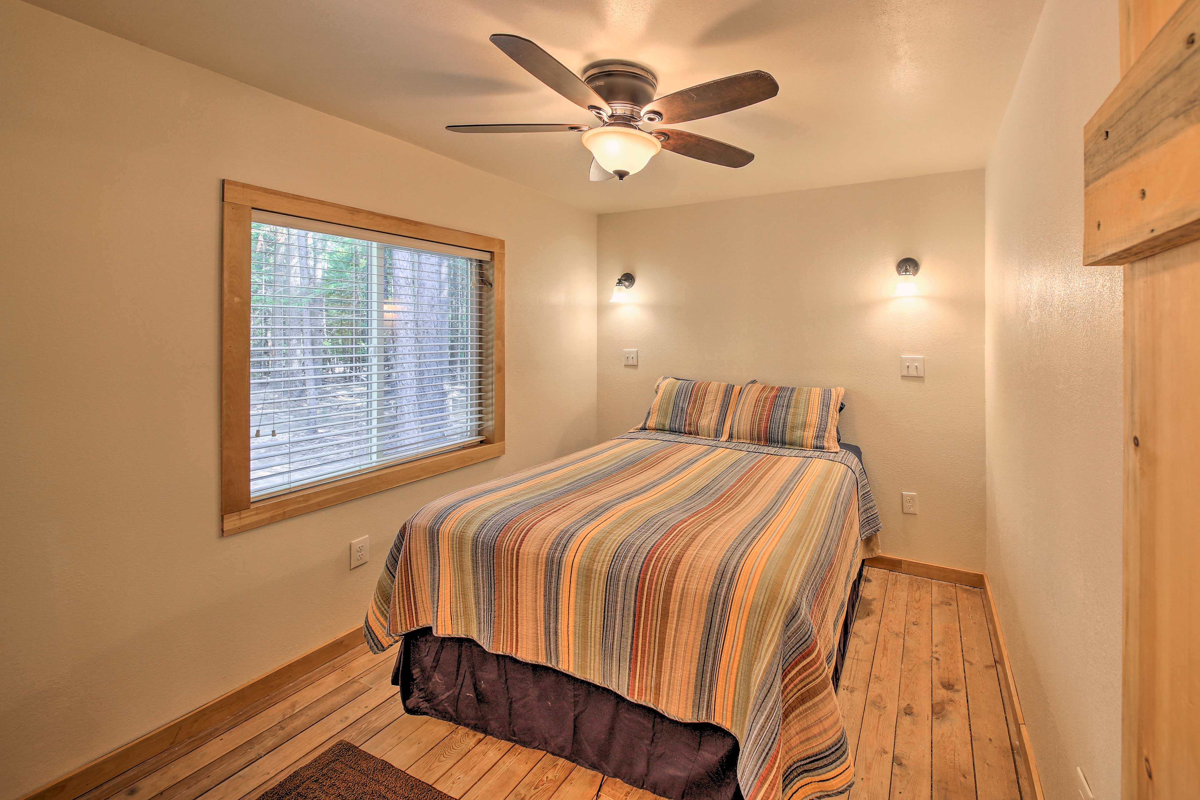 The bedroom features a cozy queen bed.