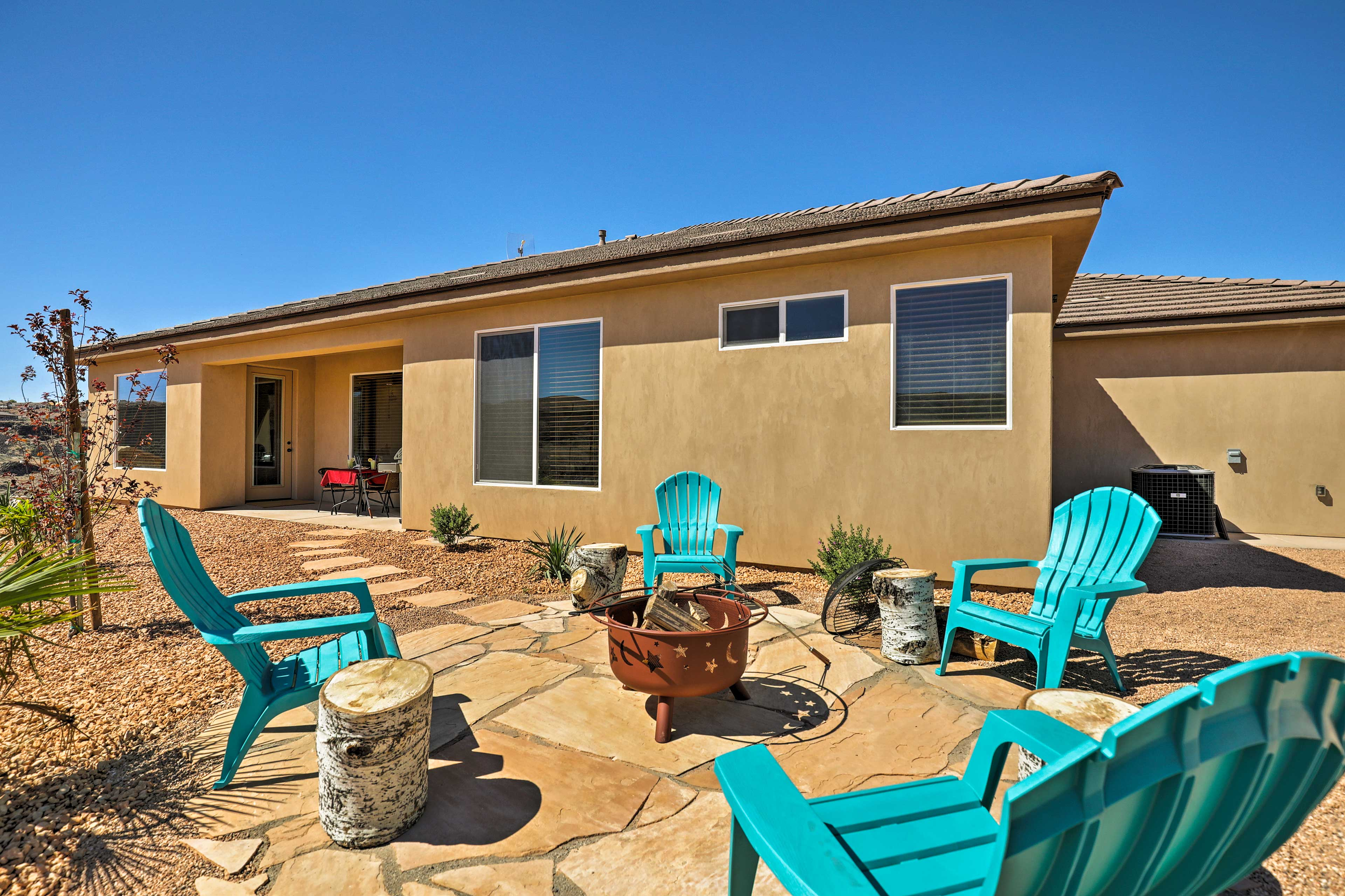 The property has a fire pit that overlooks the beautiful desert landscape.