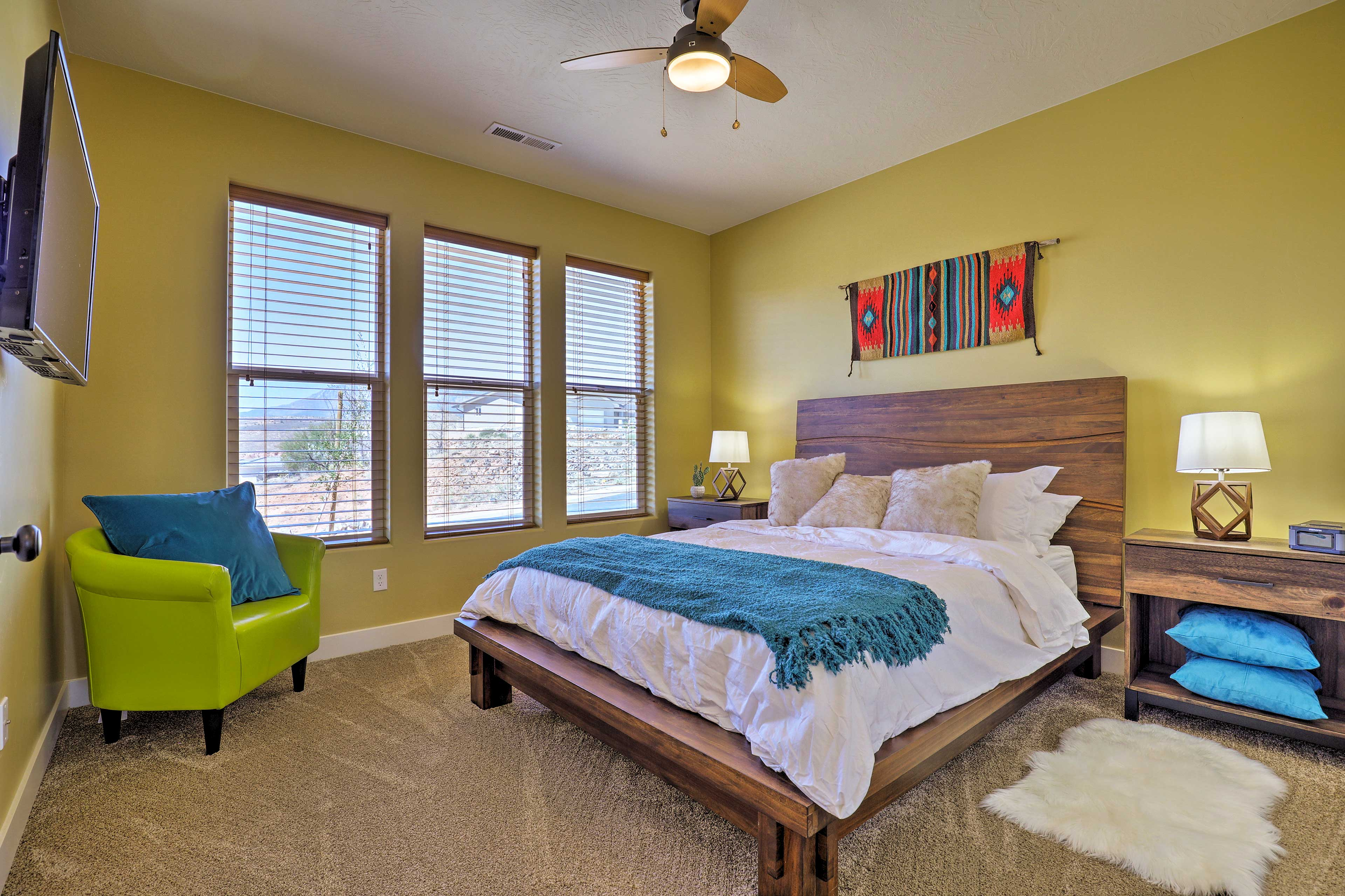 This colorful bedroom features a queen-sized bed.