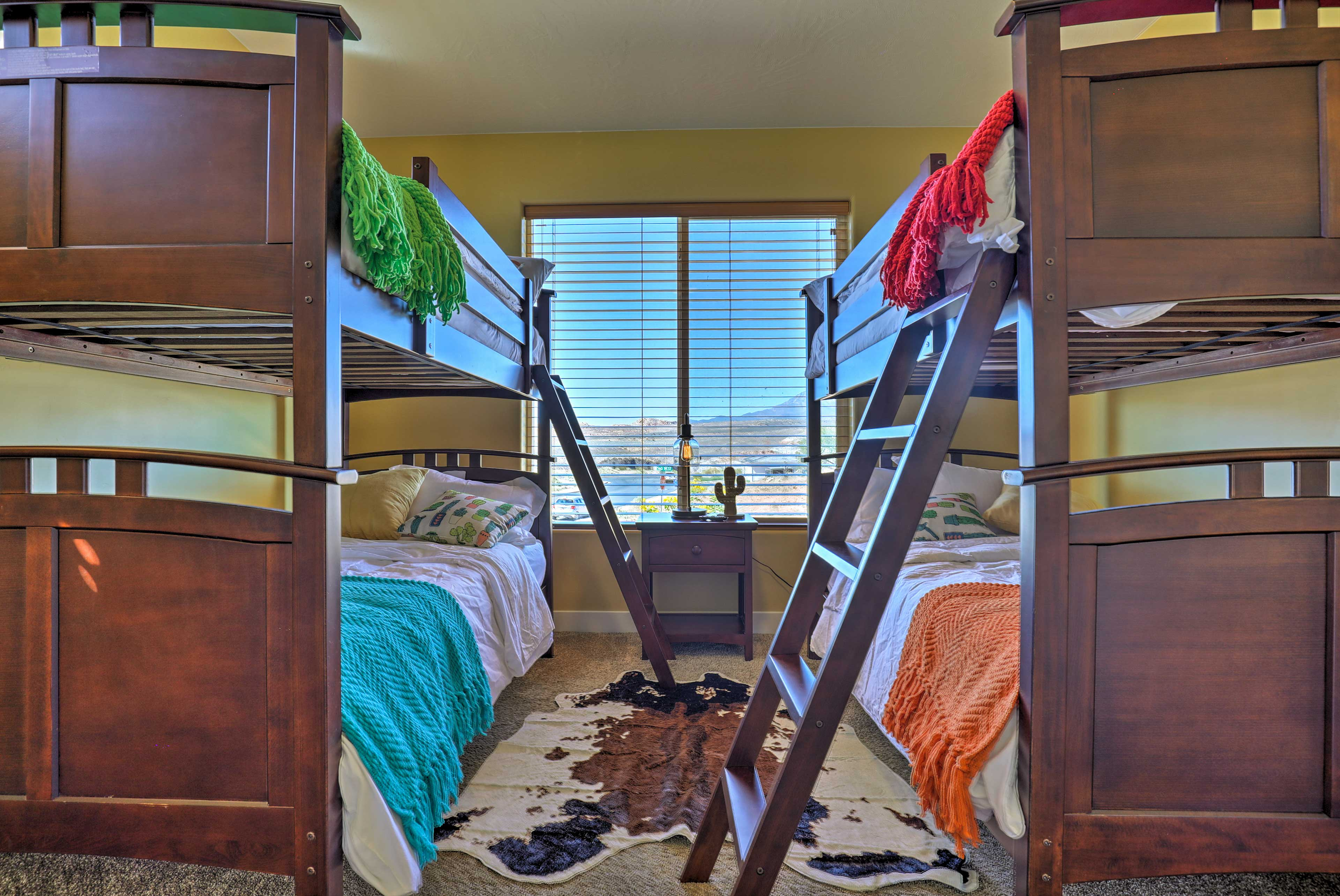 The 2 twin-over-twin bunk beds can sleep 4 people.