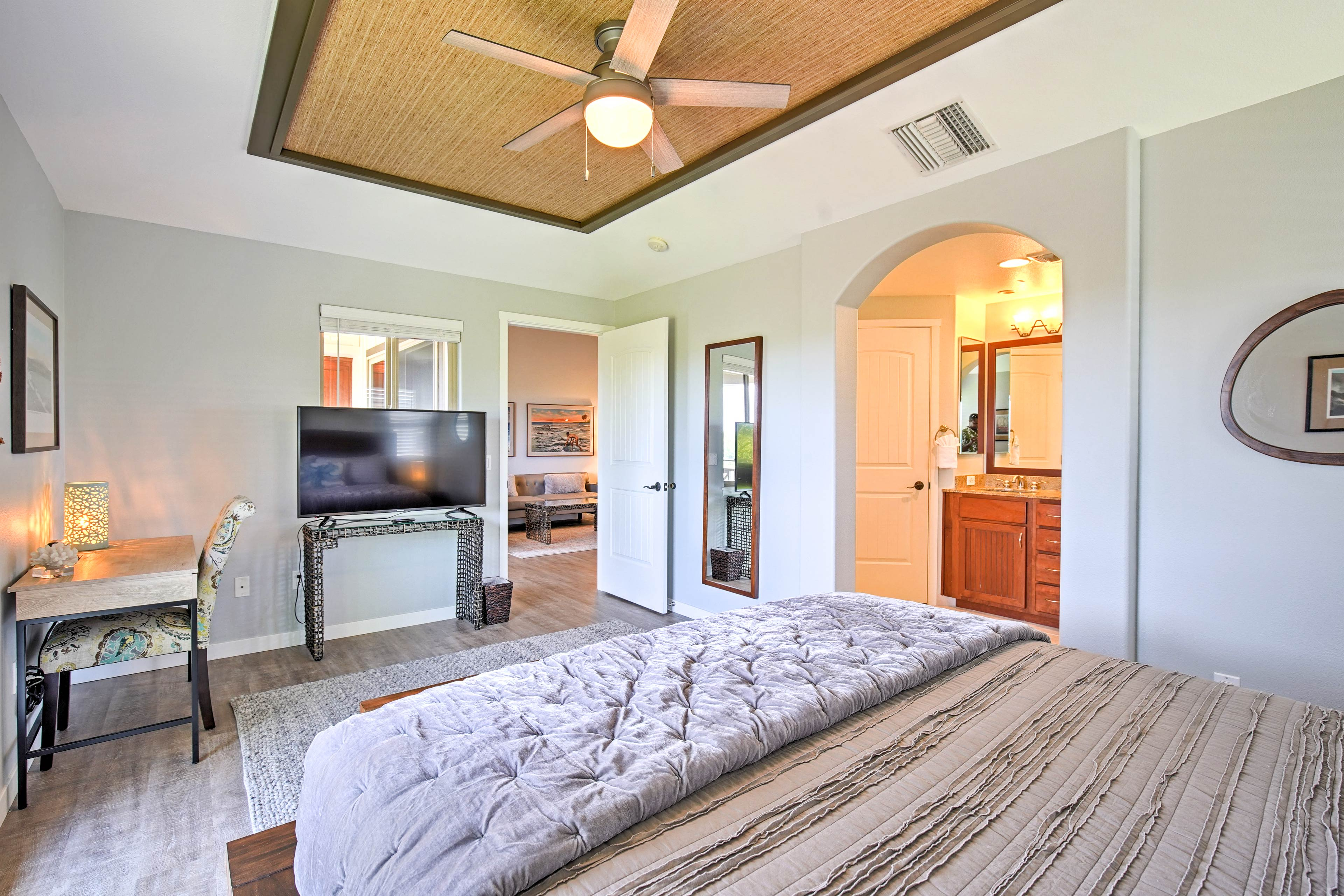 Watch the flat-screen TV as you drift off in the master bedroom.