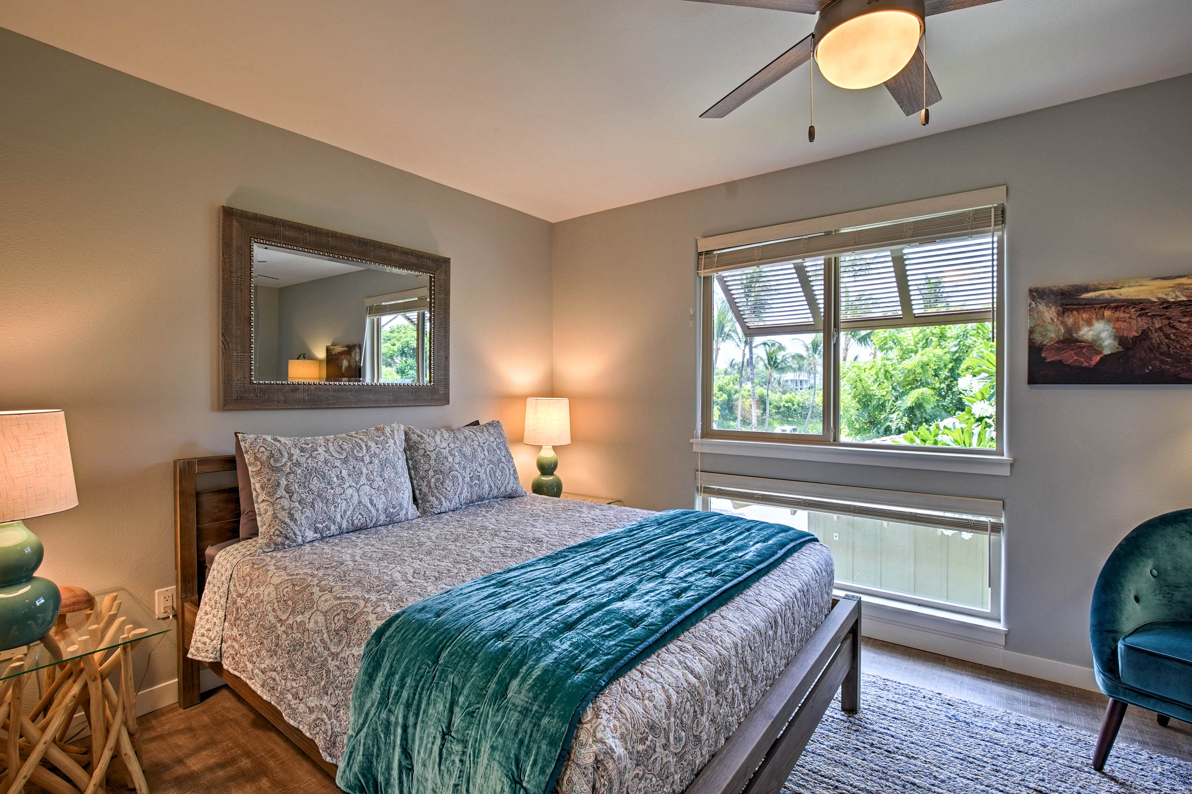 A quiet night's sleep awaits in the second bedroom featuring a queen bed.