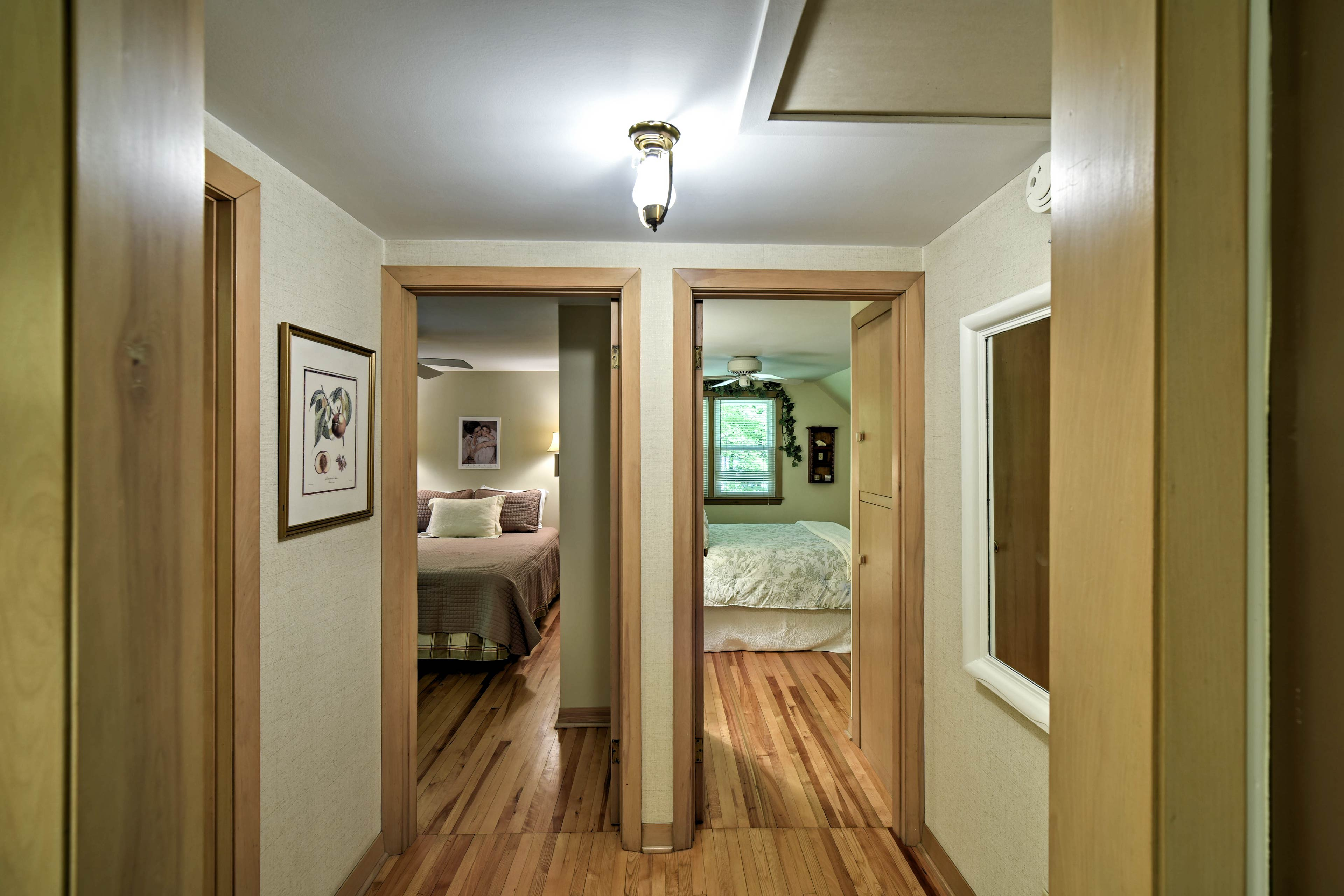 Down the hall you'll be  directed to both of the queen bedrooms.