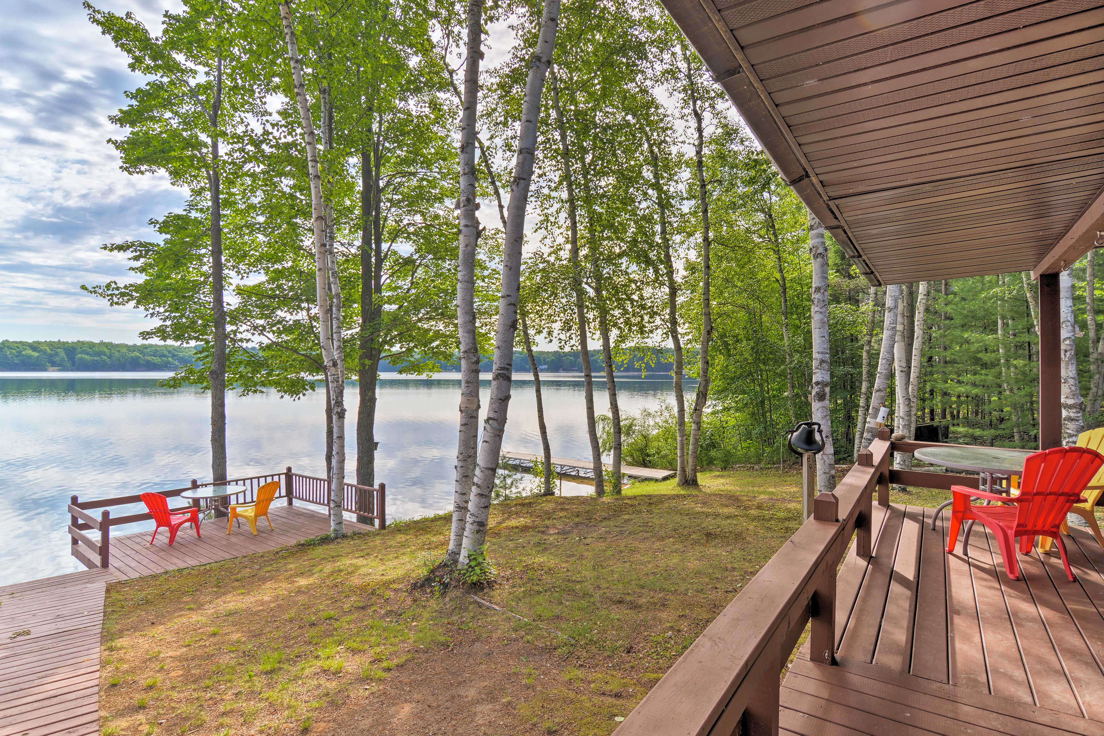 Escape to the shore at Gooseneck Lake at this Manistique vacation rental cabin.